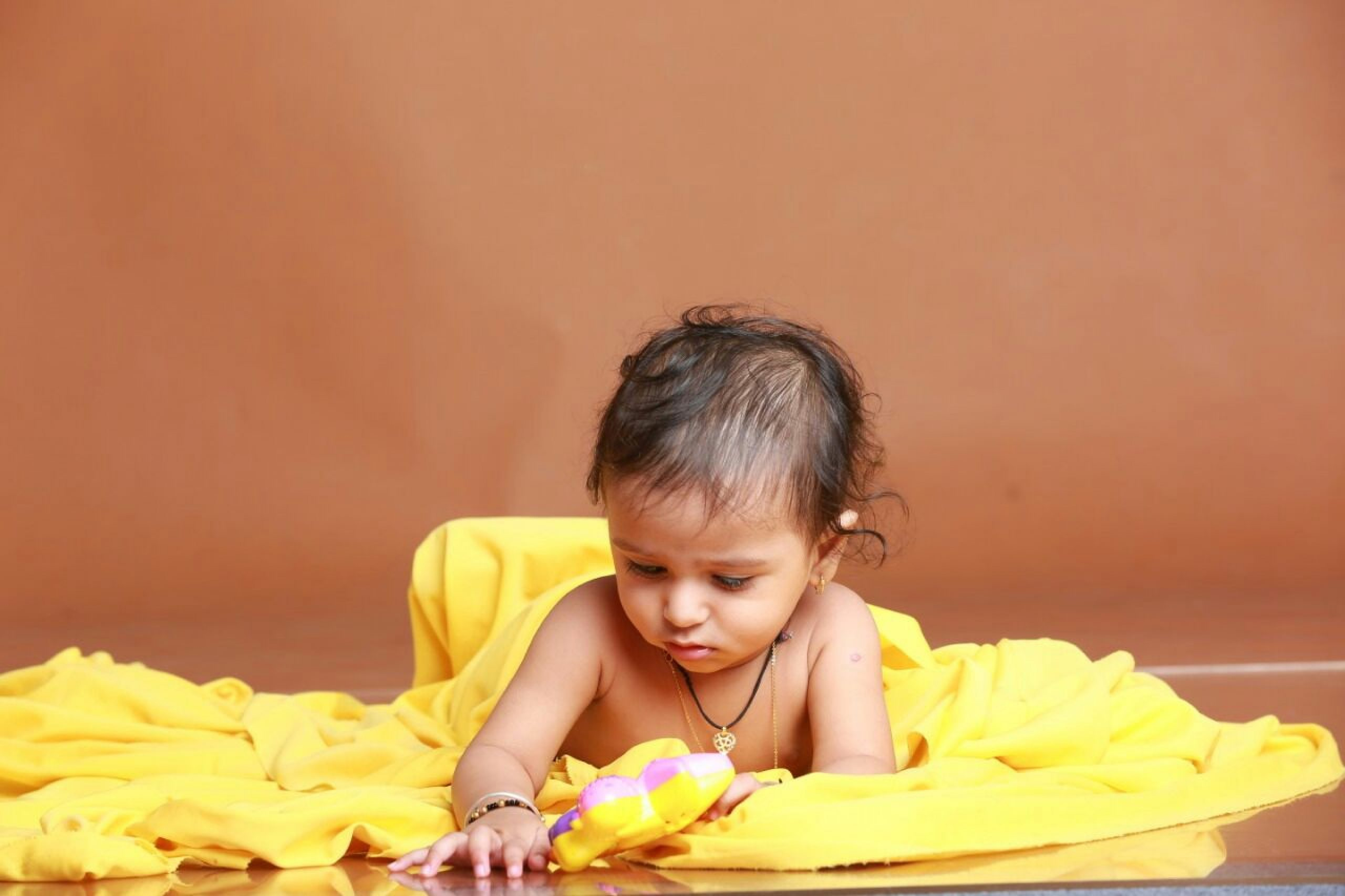 A baby playing with toys