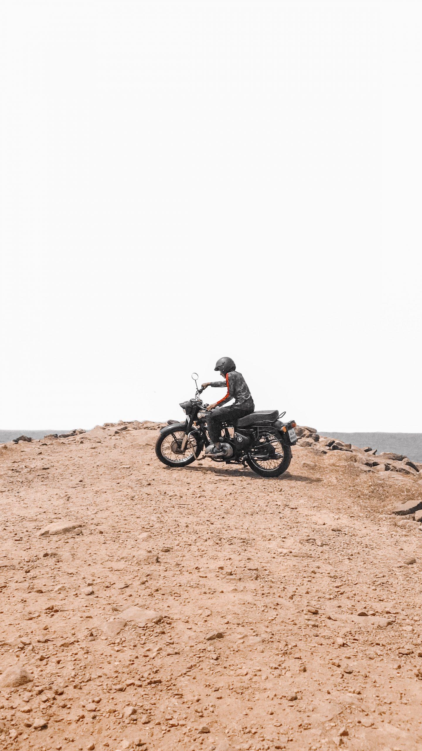 A bike rider on mountain top