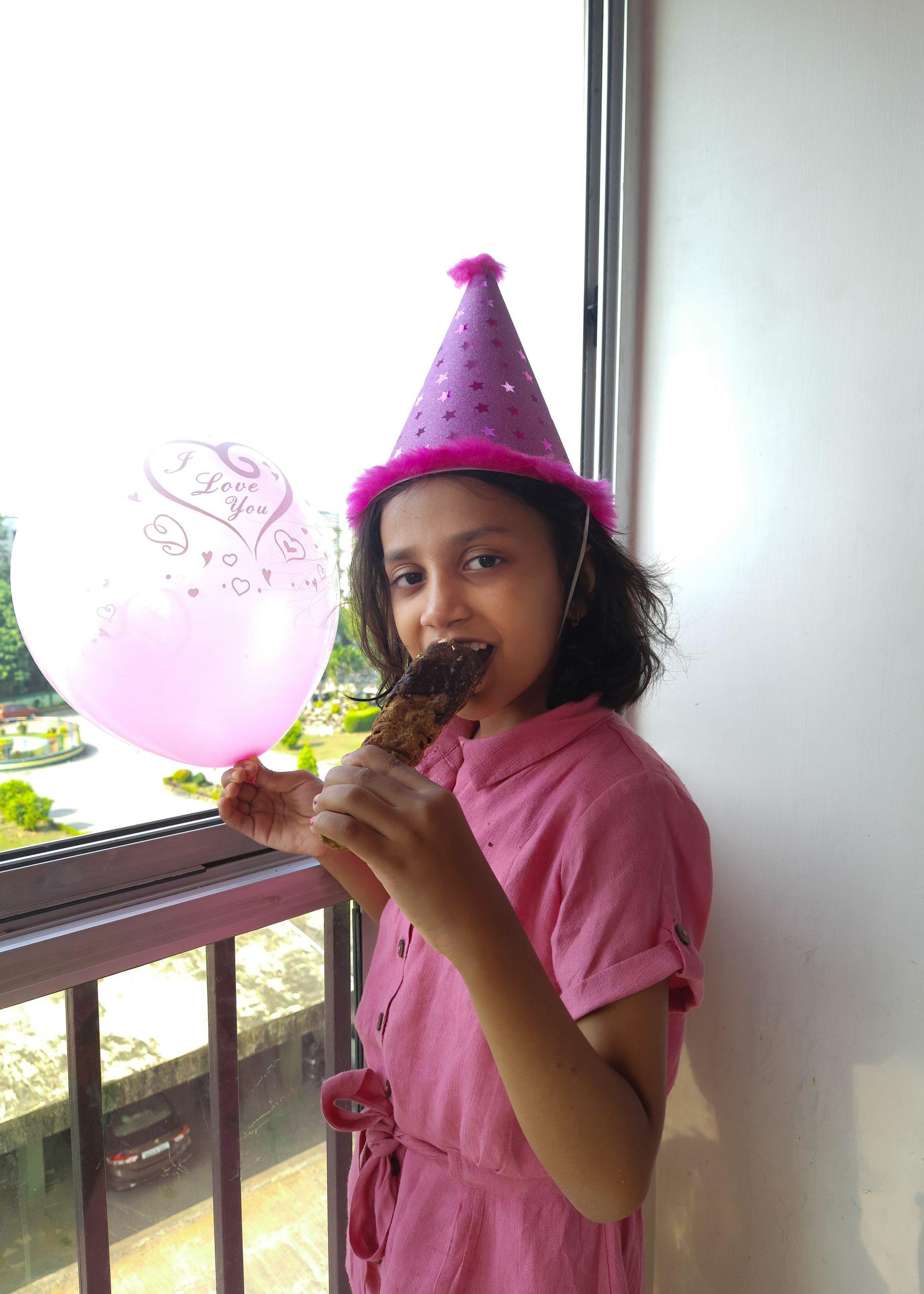 A birthday girl enjoying sweets at home