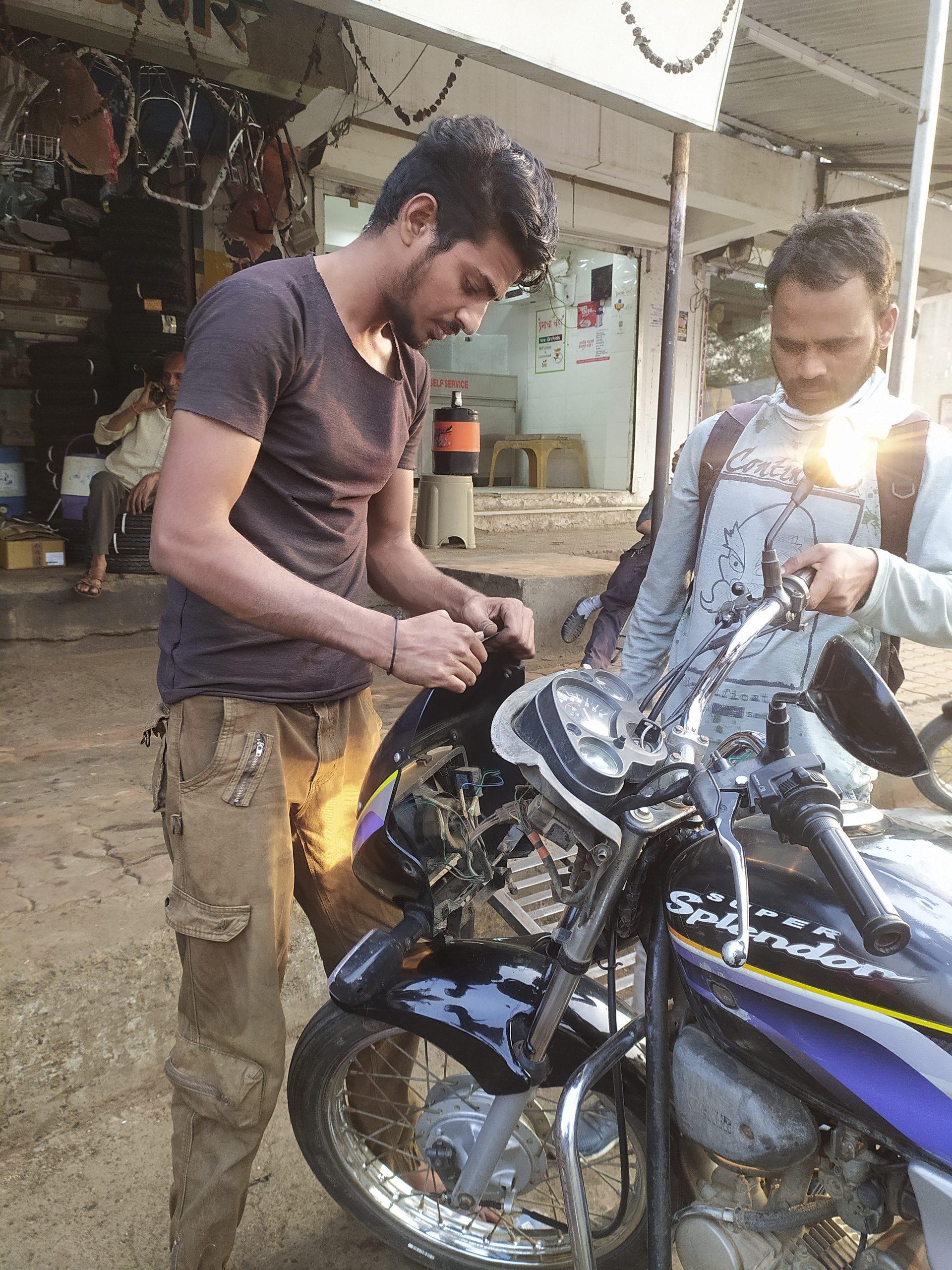 A boy repairing bike head light