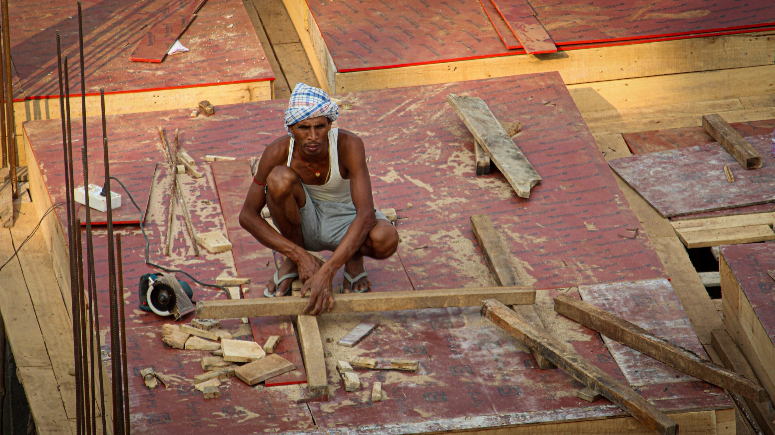 A carpenter working on woods