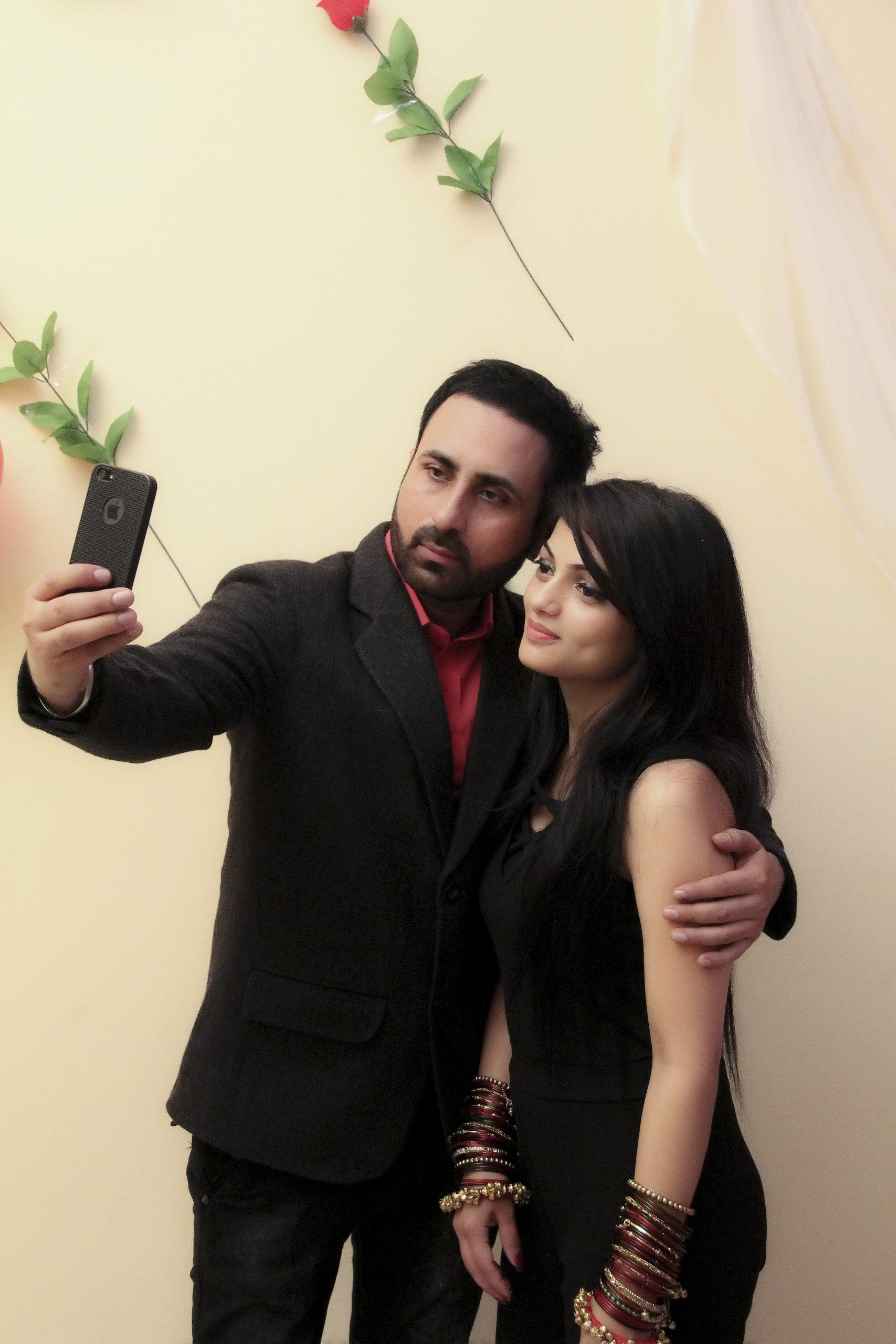 A couple taking selfie