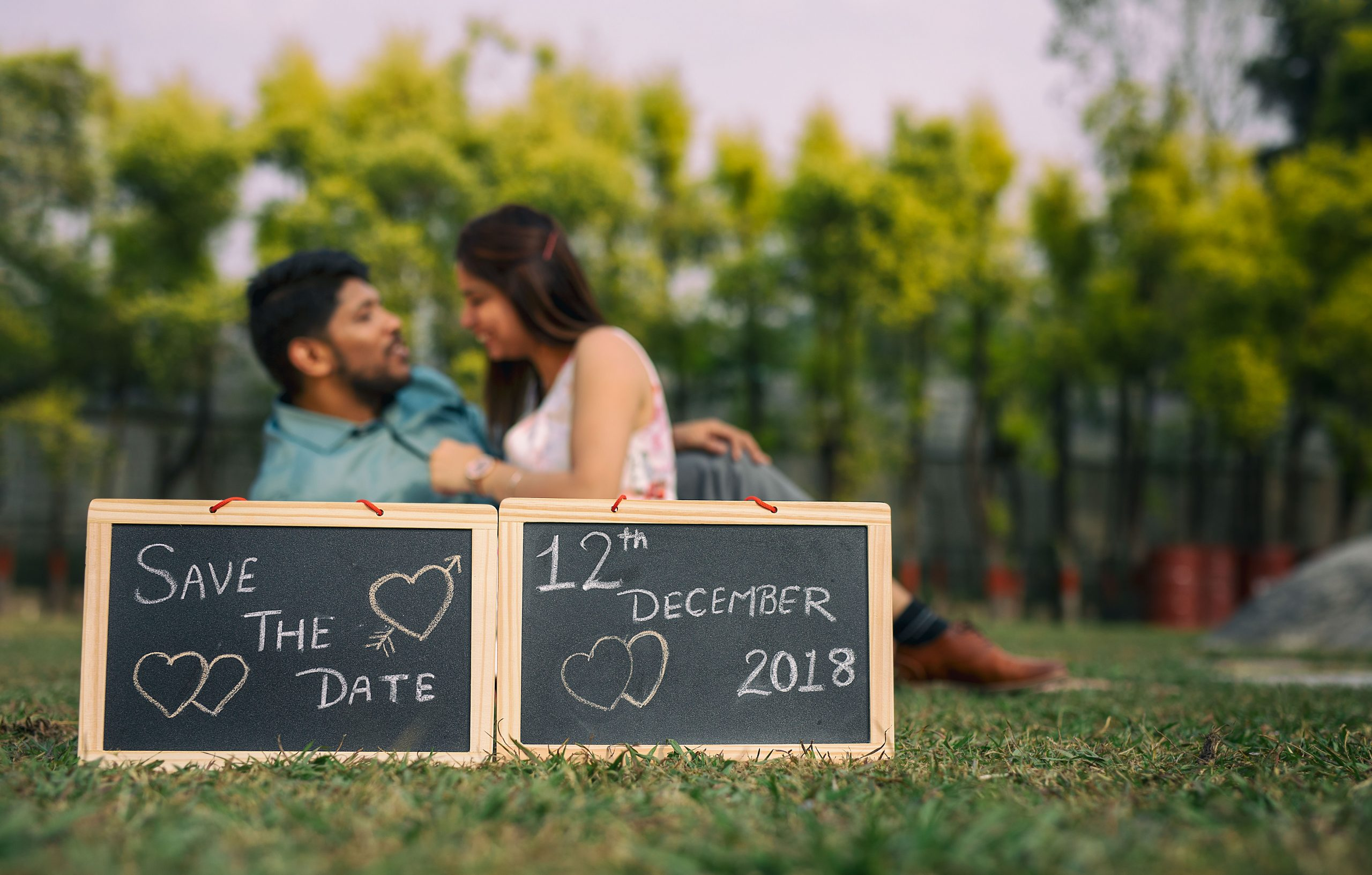 A couple with save the date board
