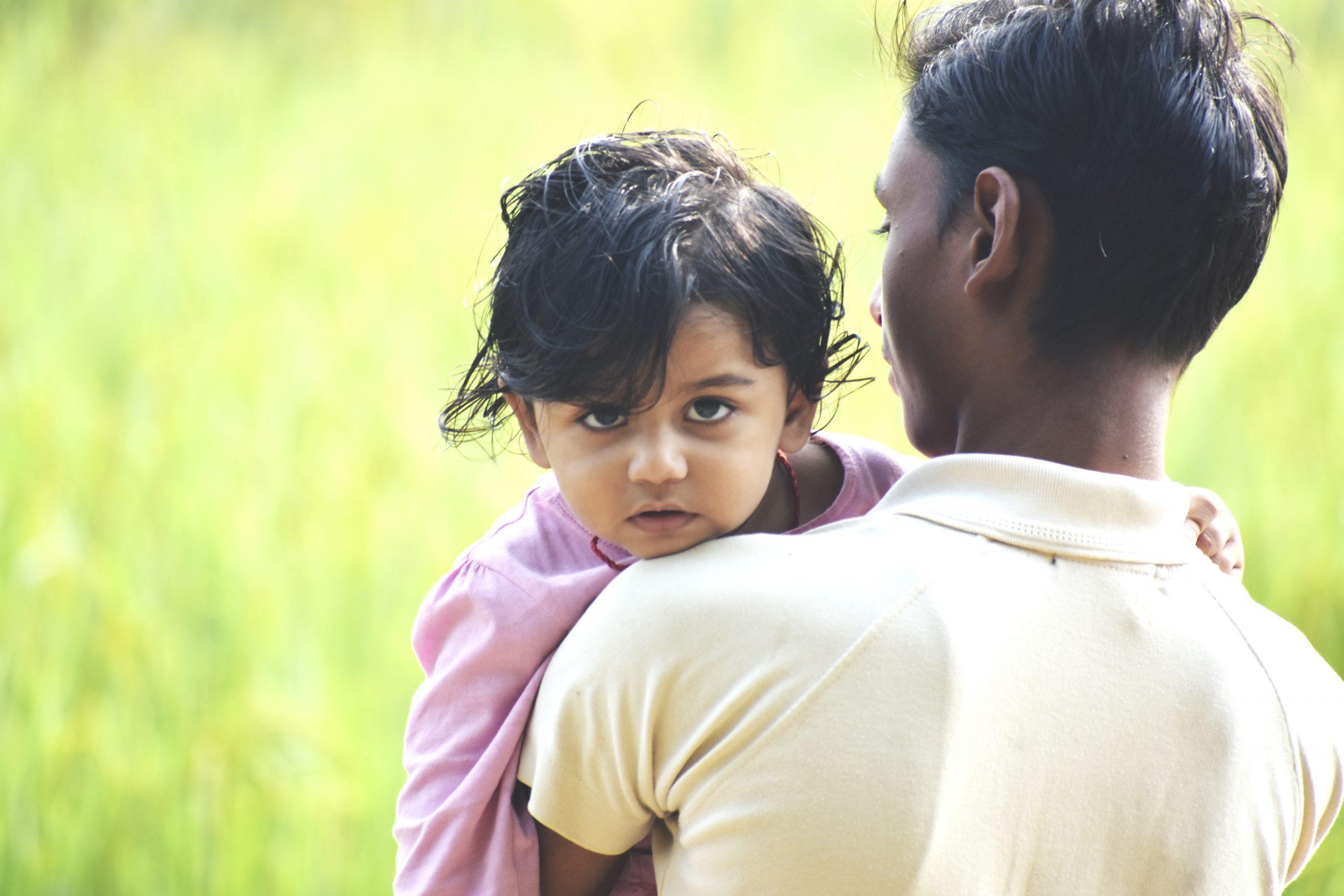 A cute kid on shoulder