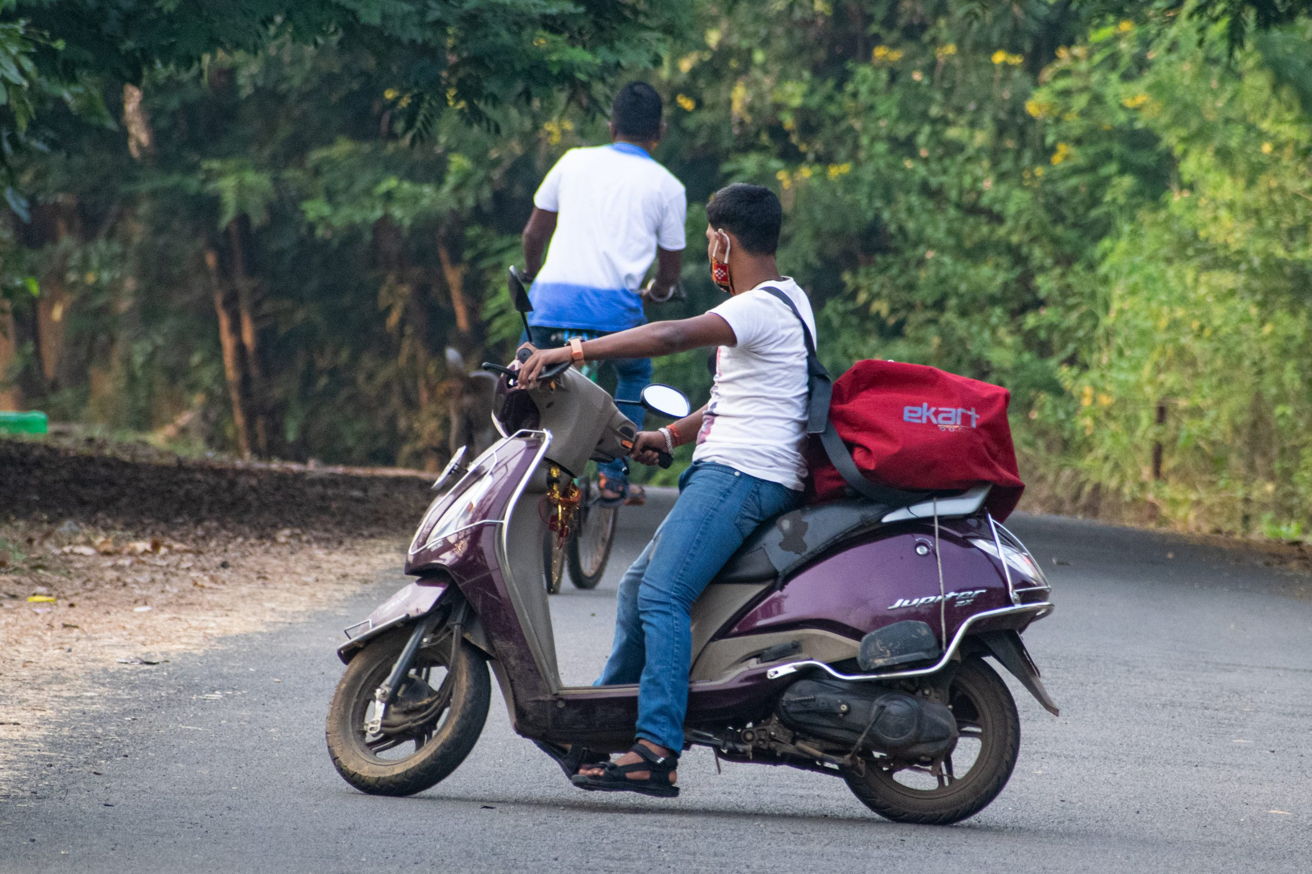 A delivery boy on a scooter