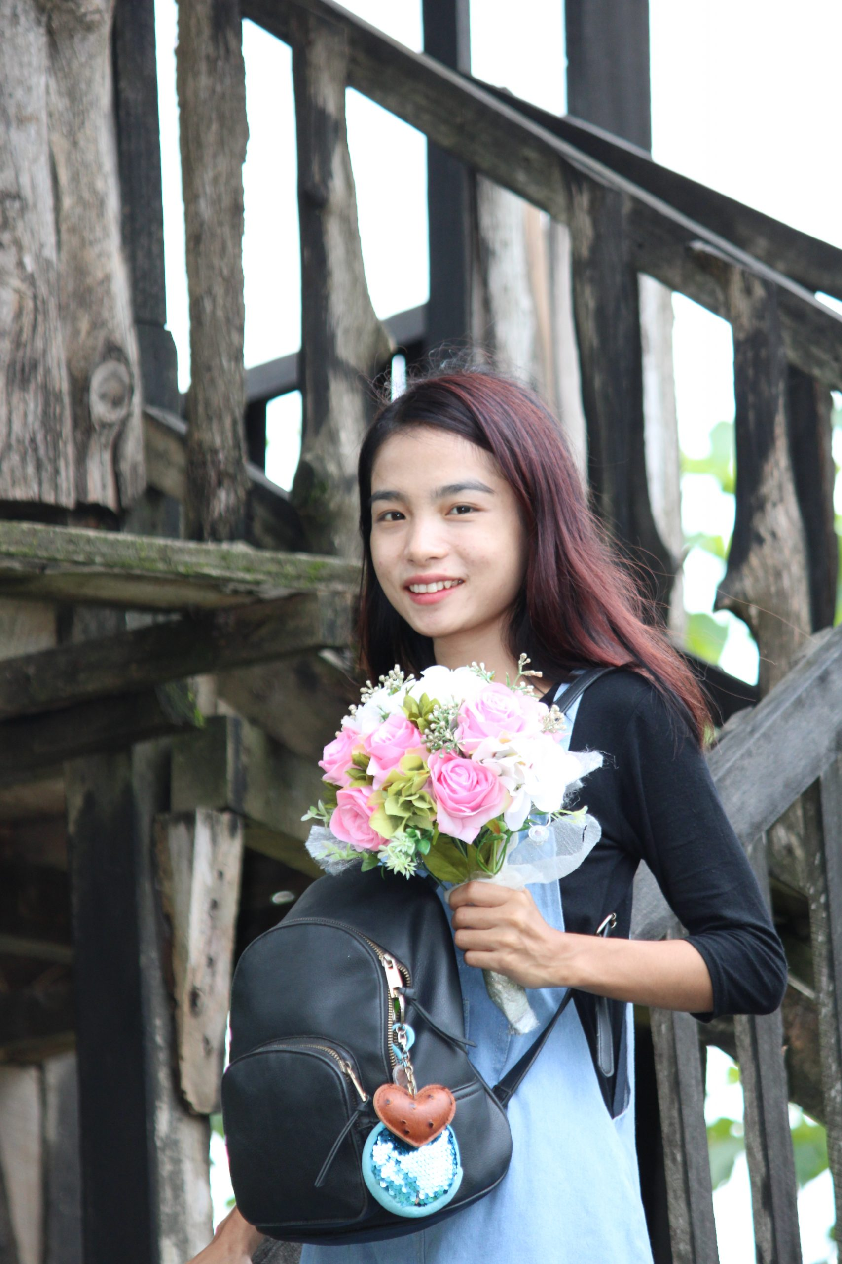 A girl with flower bouquet