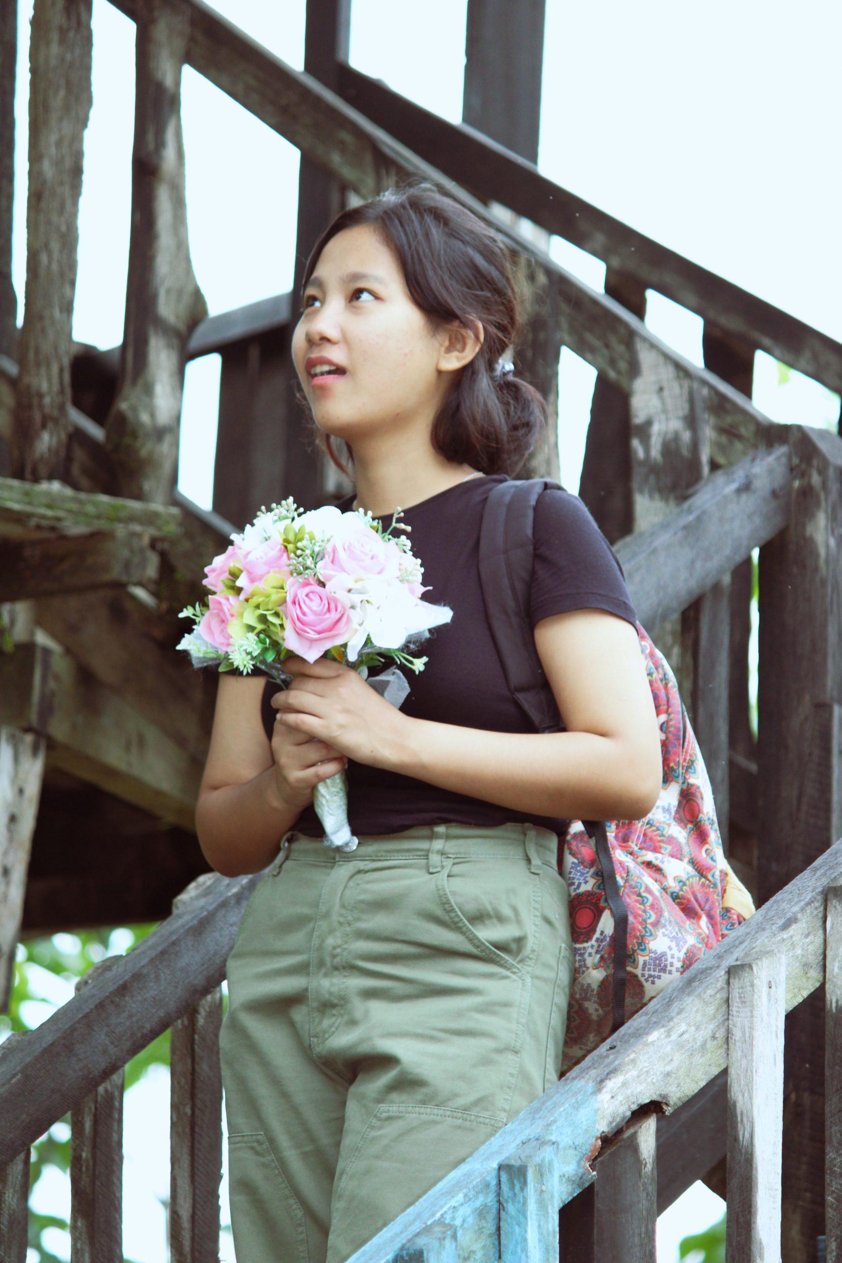 A girl holding a flower bouquet