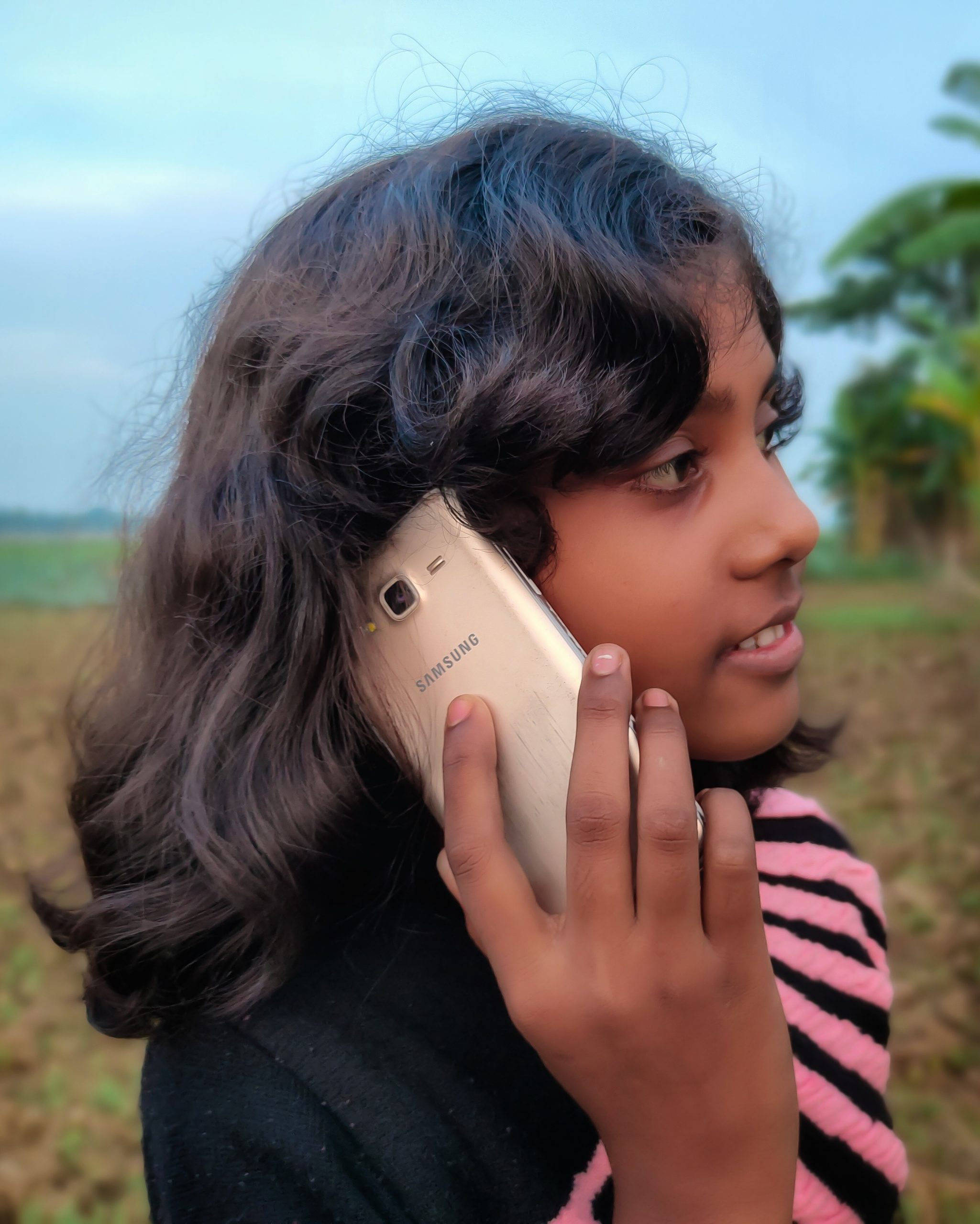 A girl is using Samsung mobile
