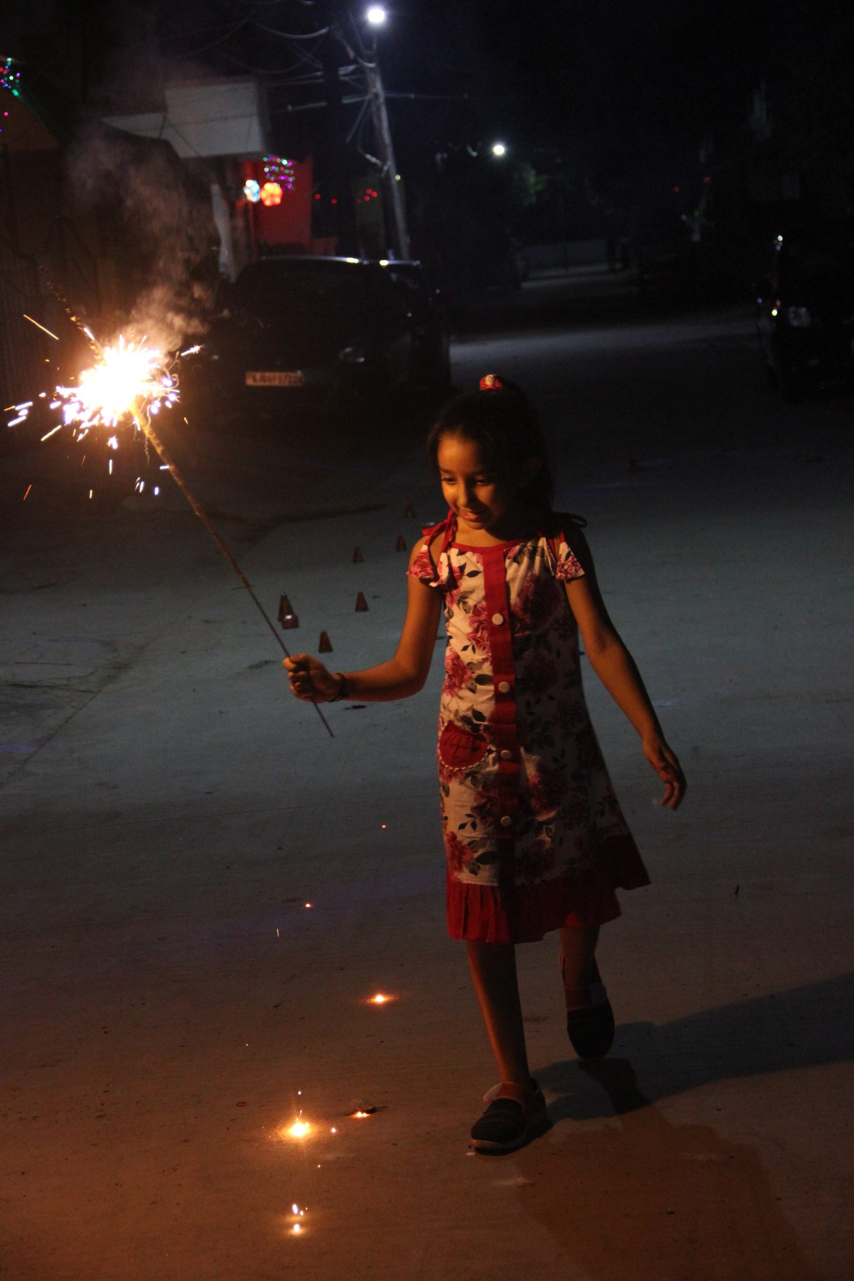 A little girl cracking sparklers