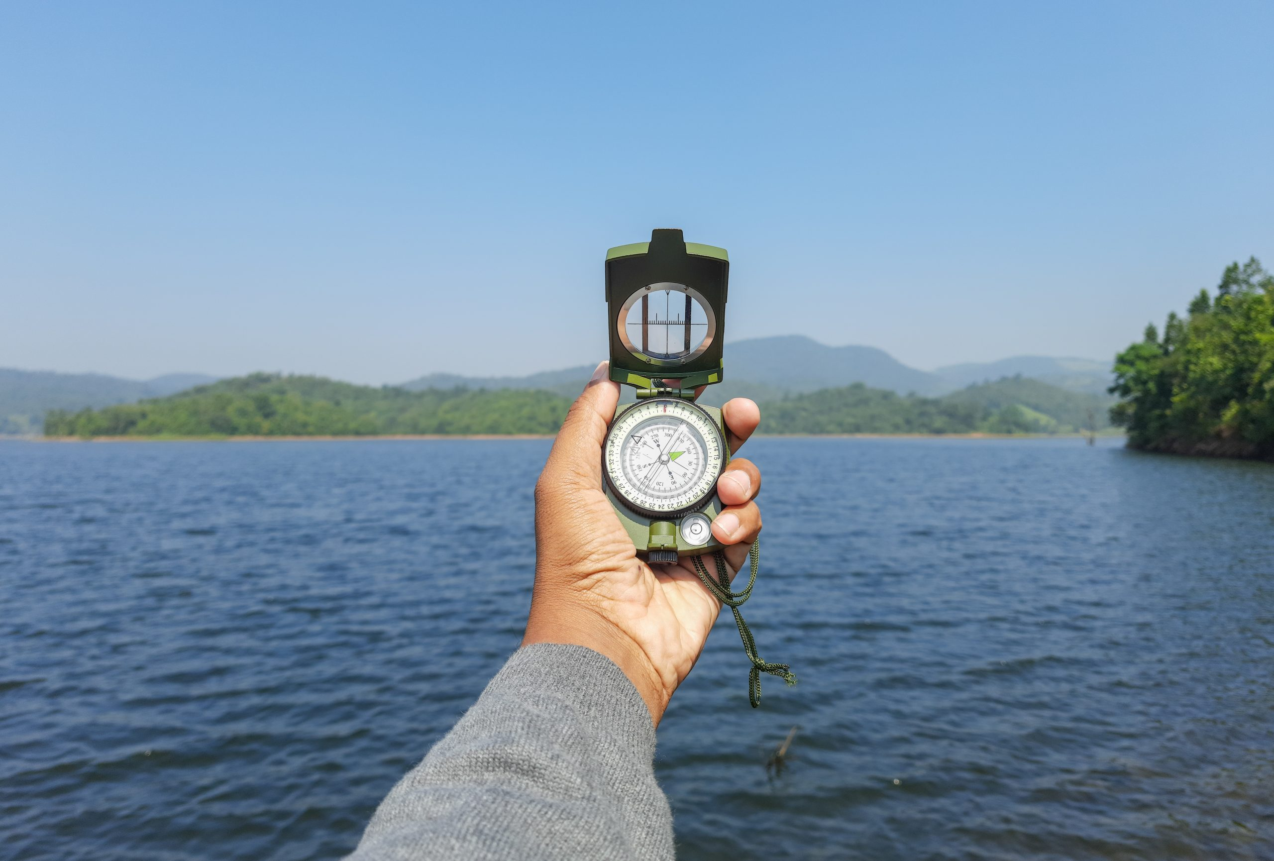 A magnetic compass in hand