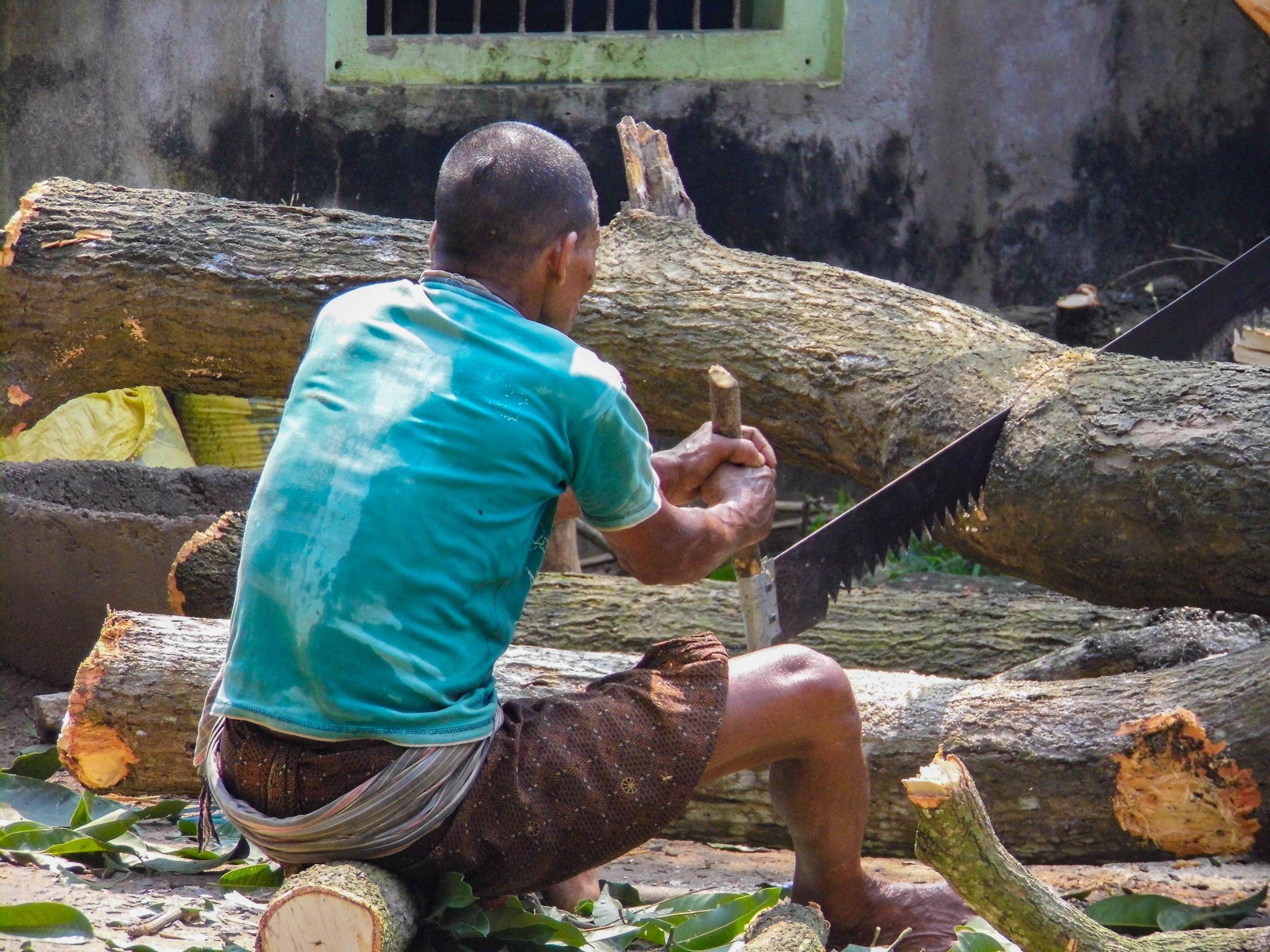 A man cutting wood