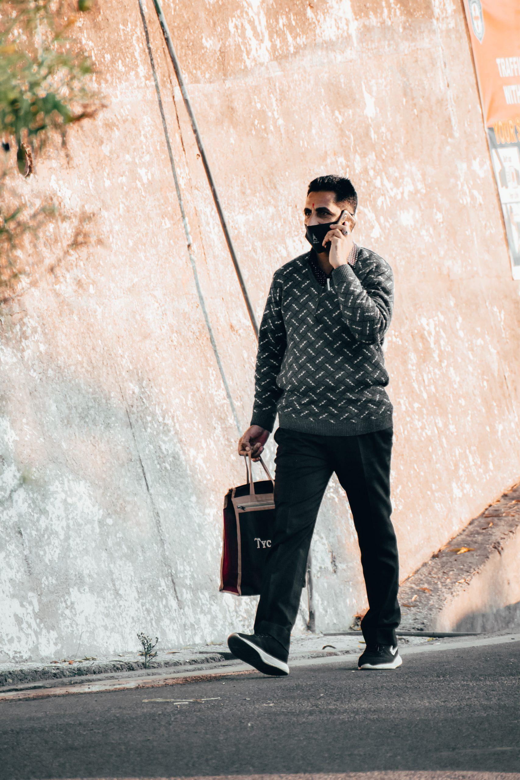 A man attending a phone call