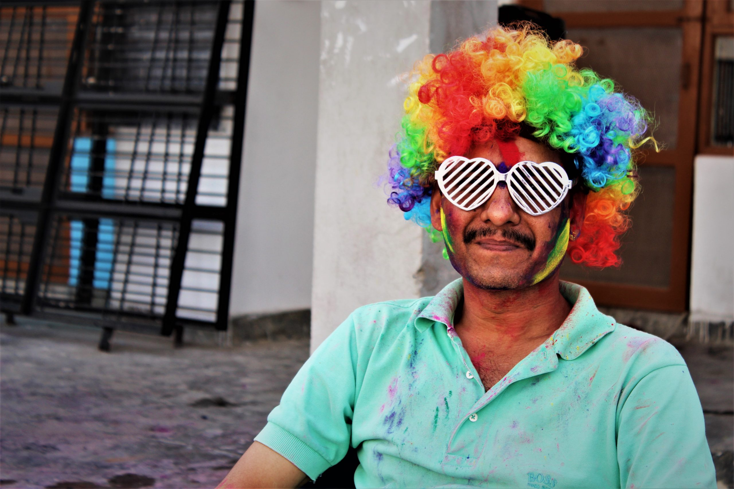 A man with artificial multicolor hair