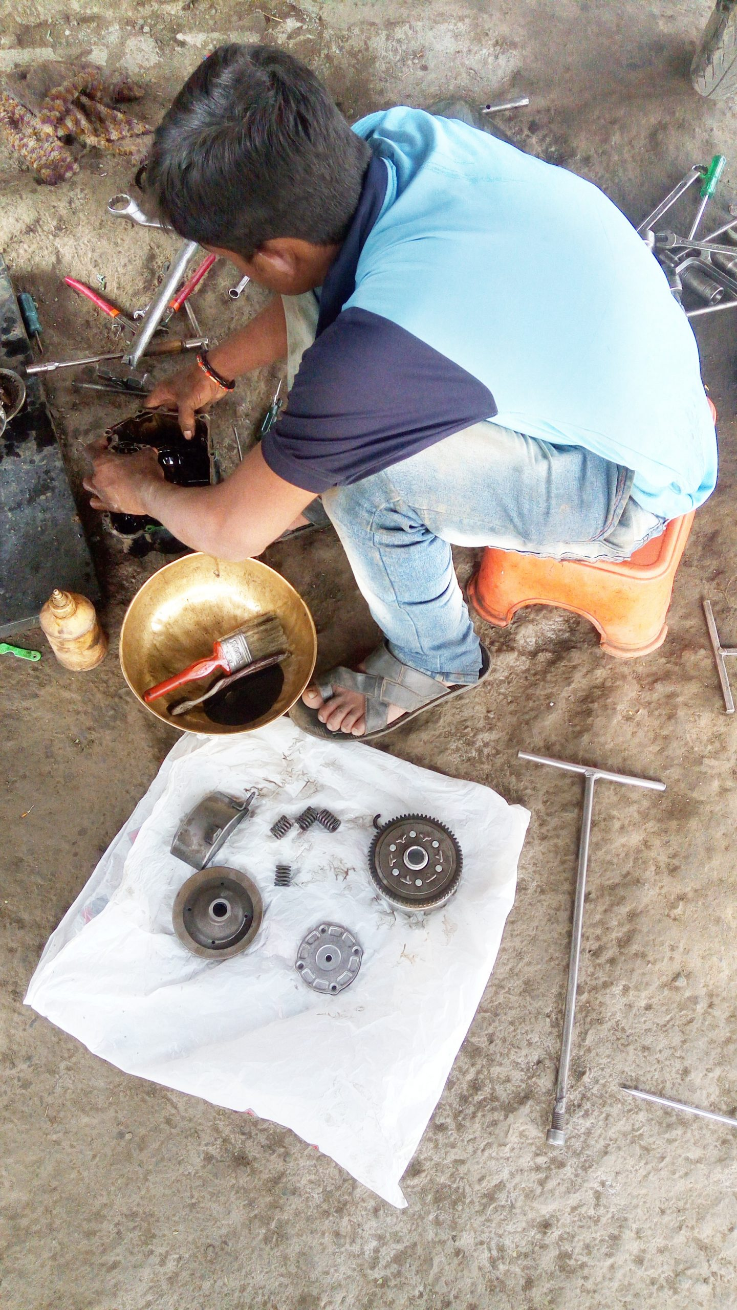 A mechanic working with tools