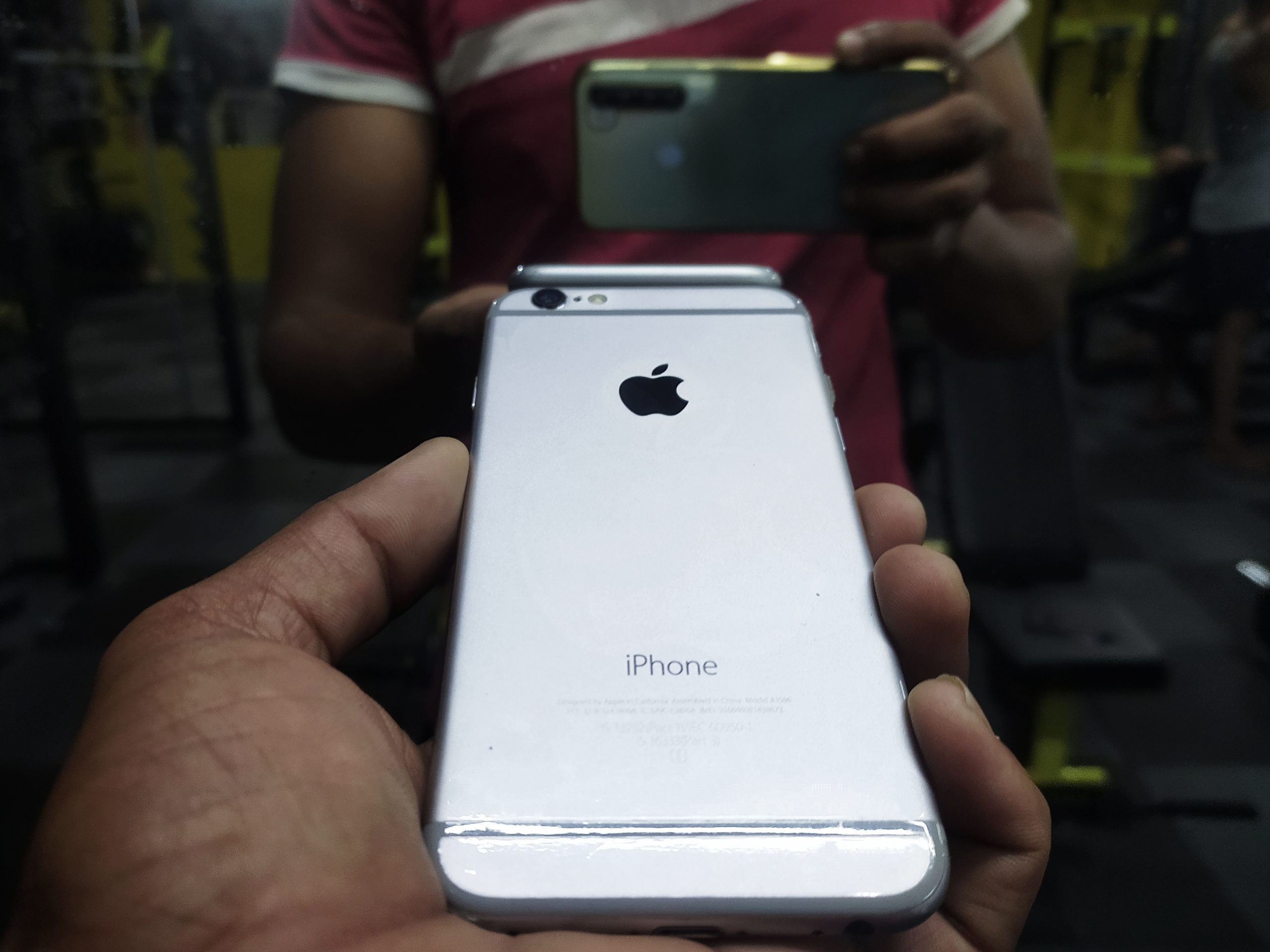 An iPhone in hand