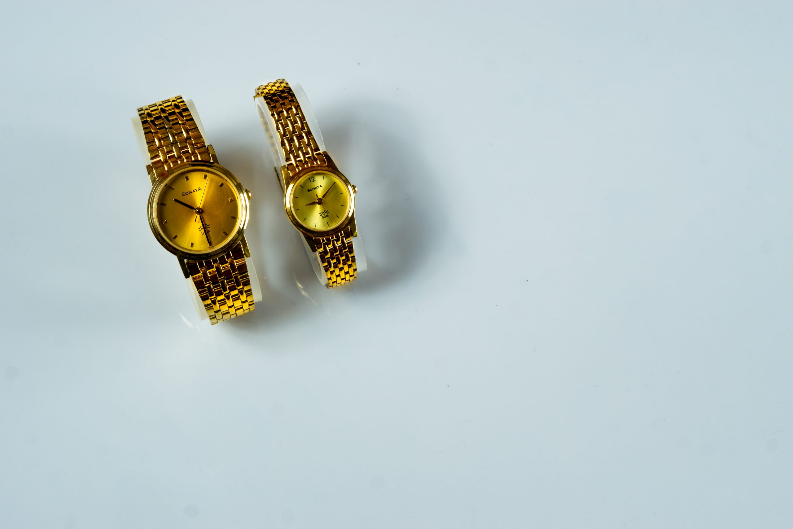 A pair of golden wrist watches