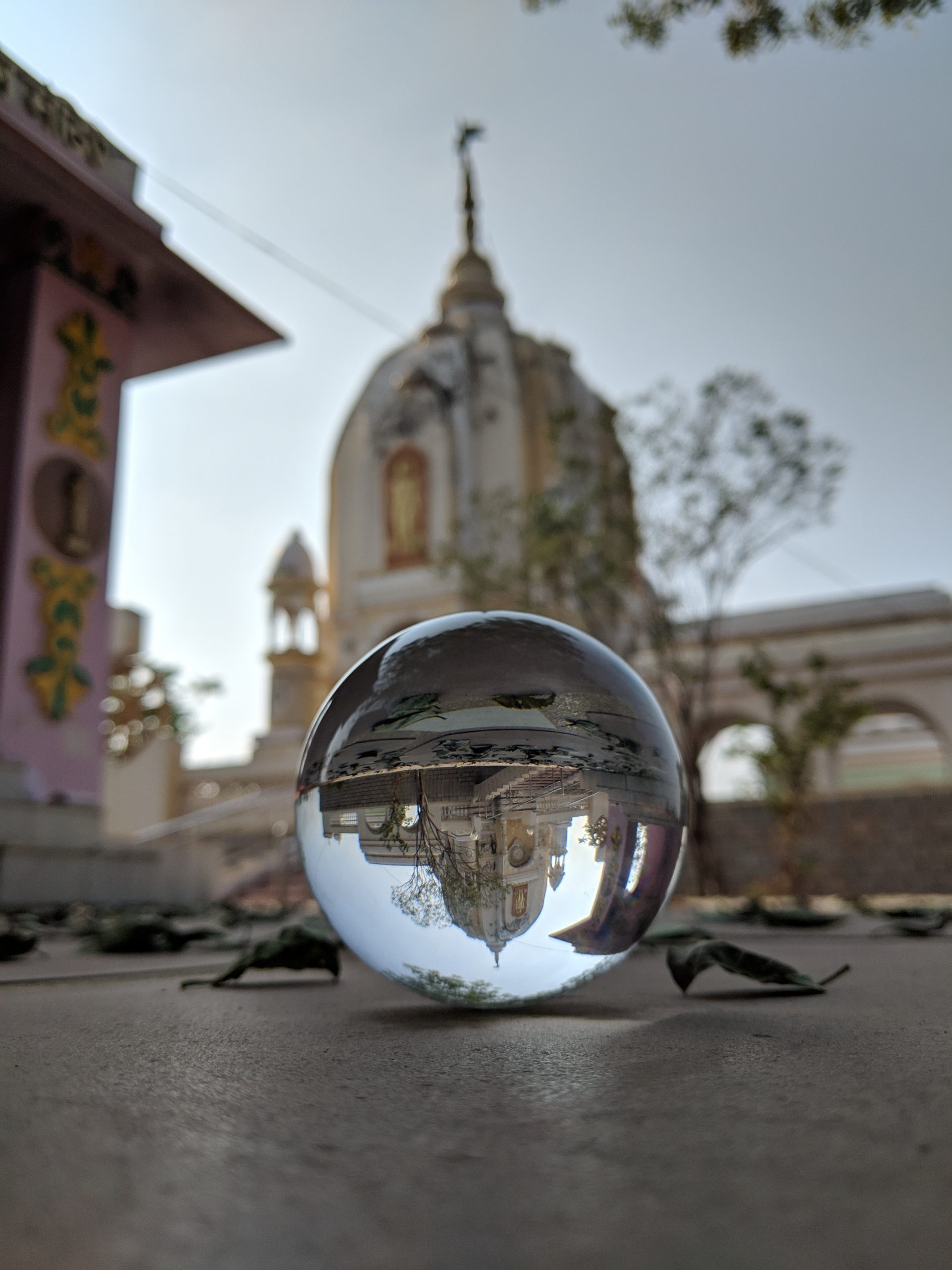 A reflection of a temple in a lensball