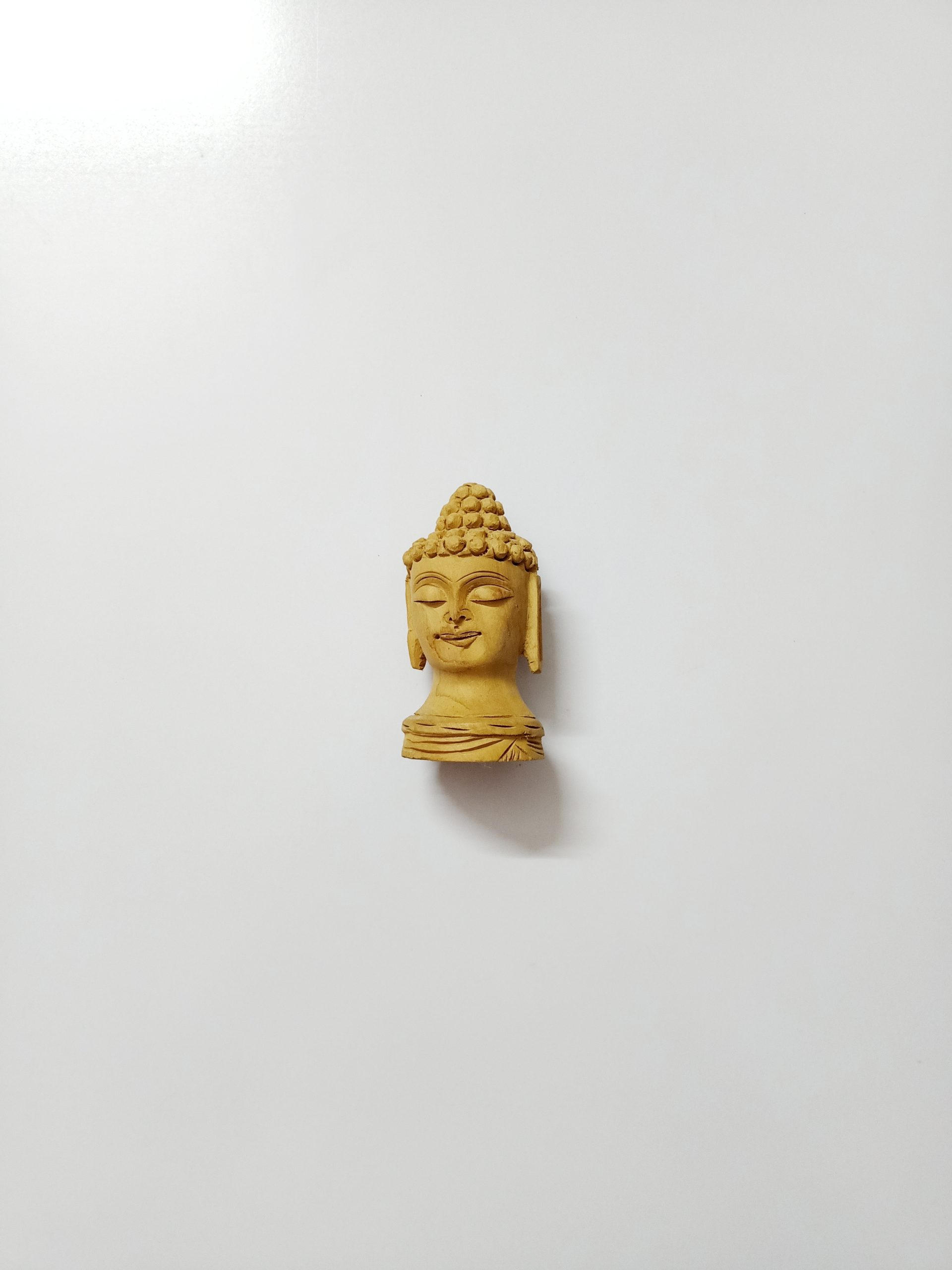A wooden statue of Buddha