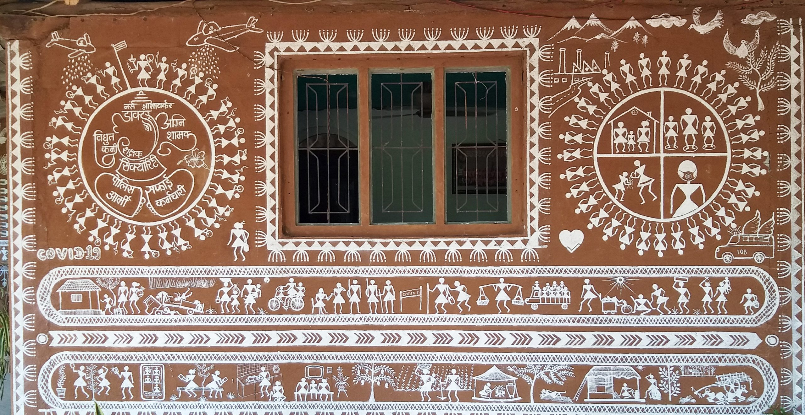 varli painting on wall