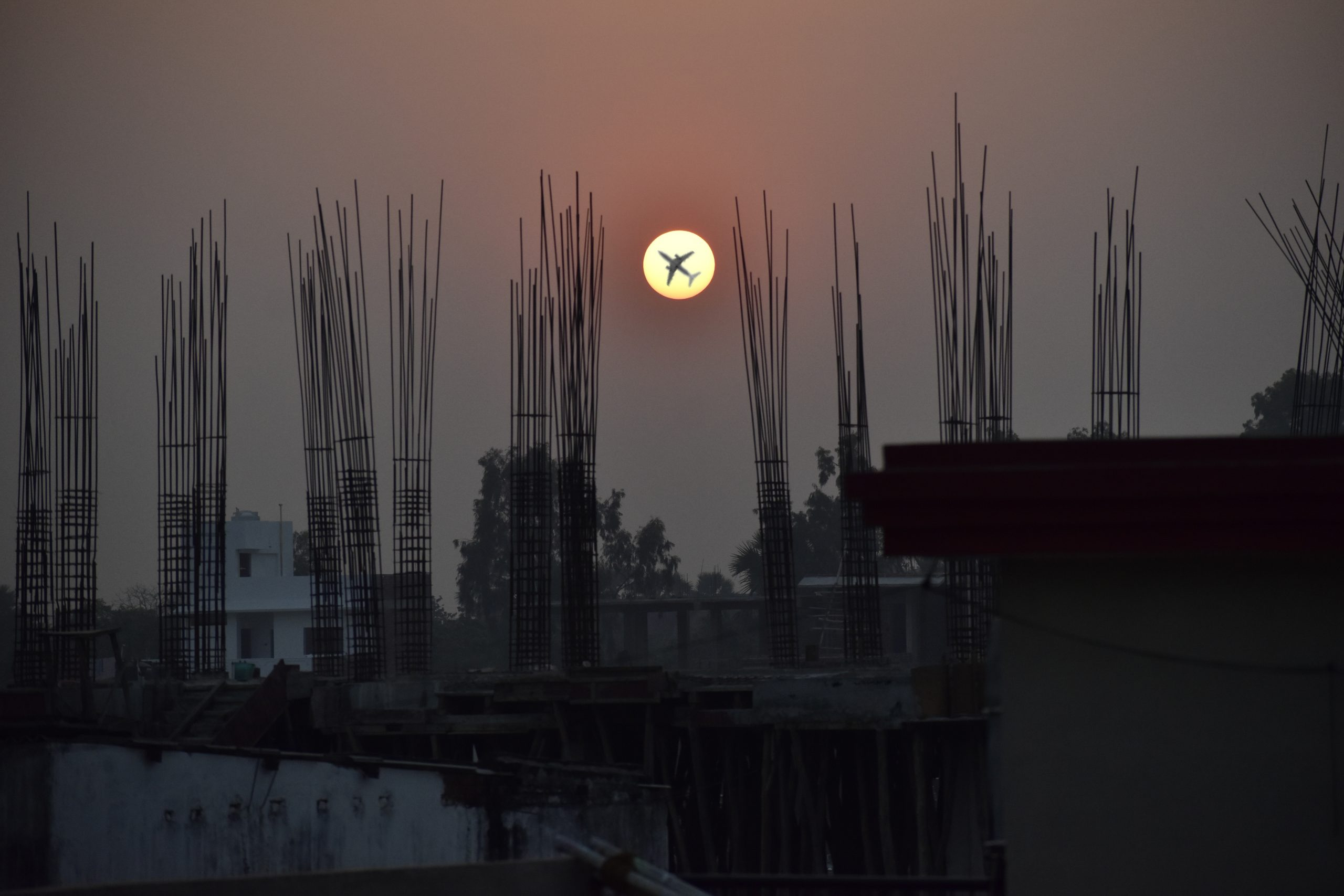 An airplane crossing by the Sun