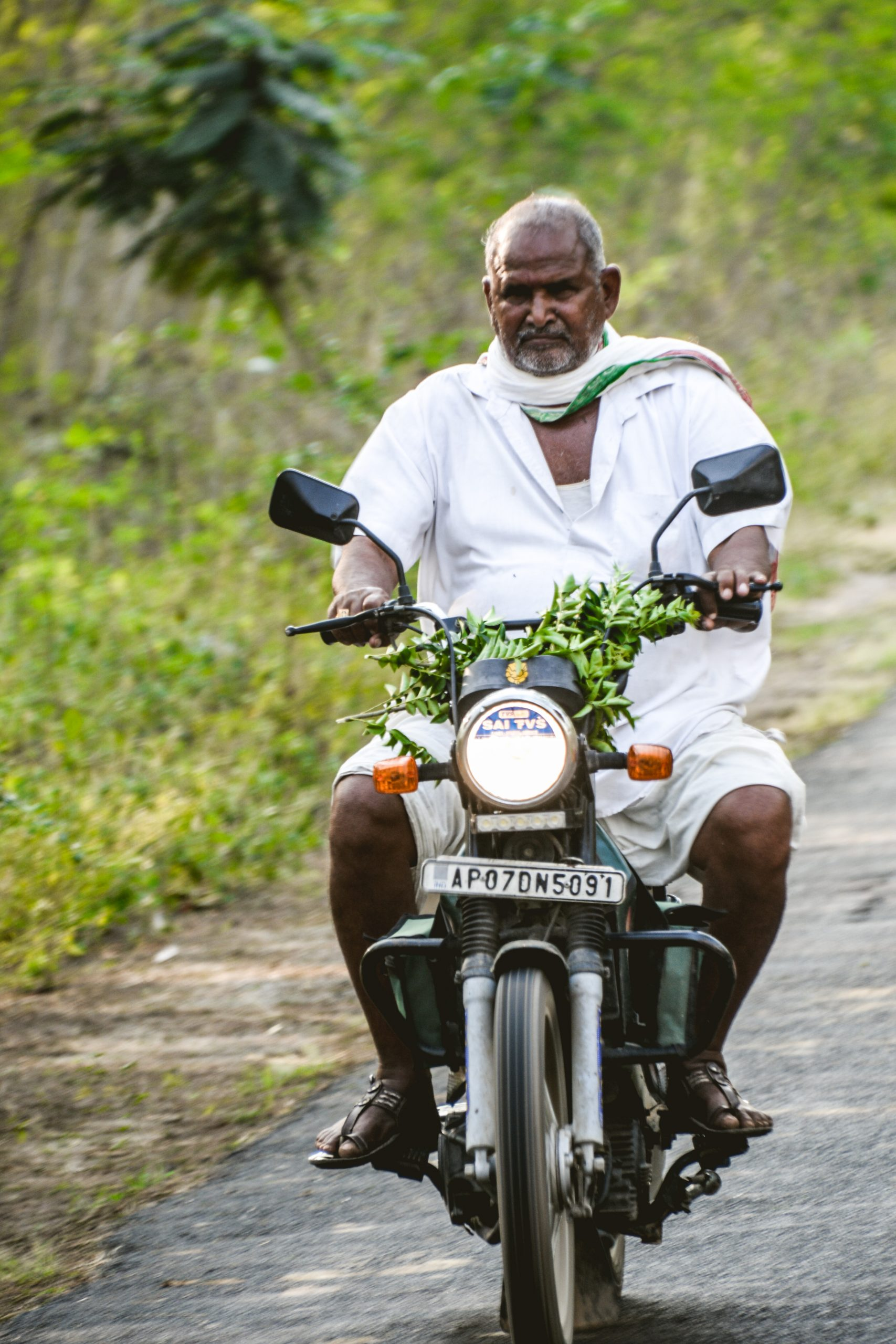 An old man on motorbike