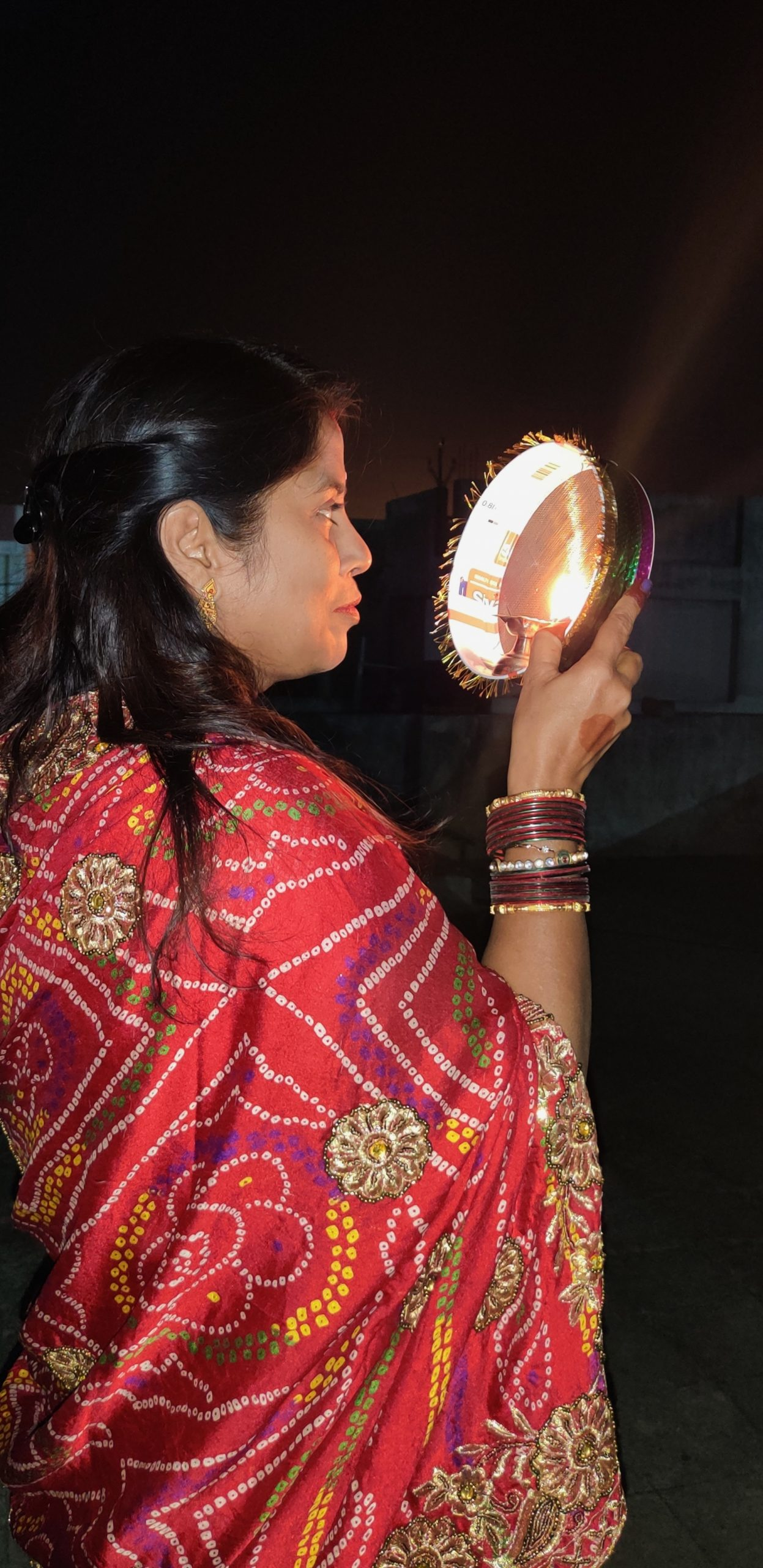 An Indian woman celebrating Karva Chauth