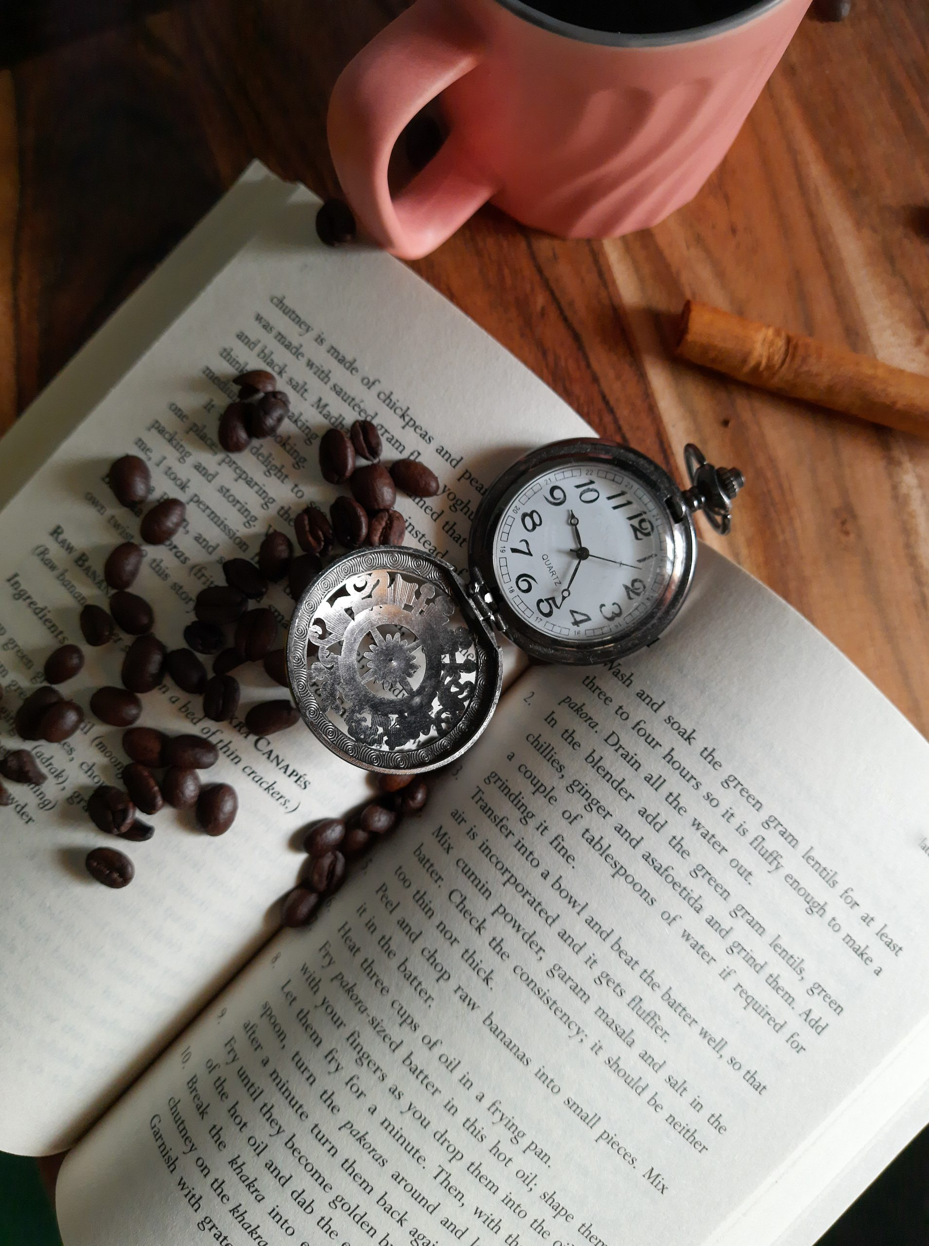 An antique watch and book