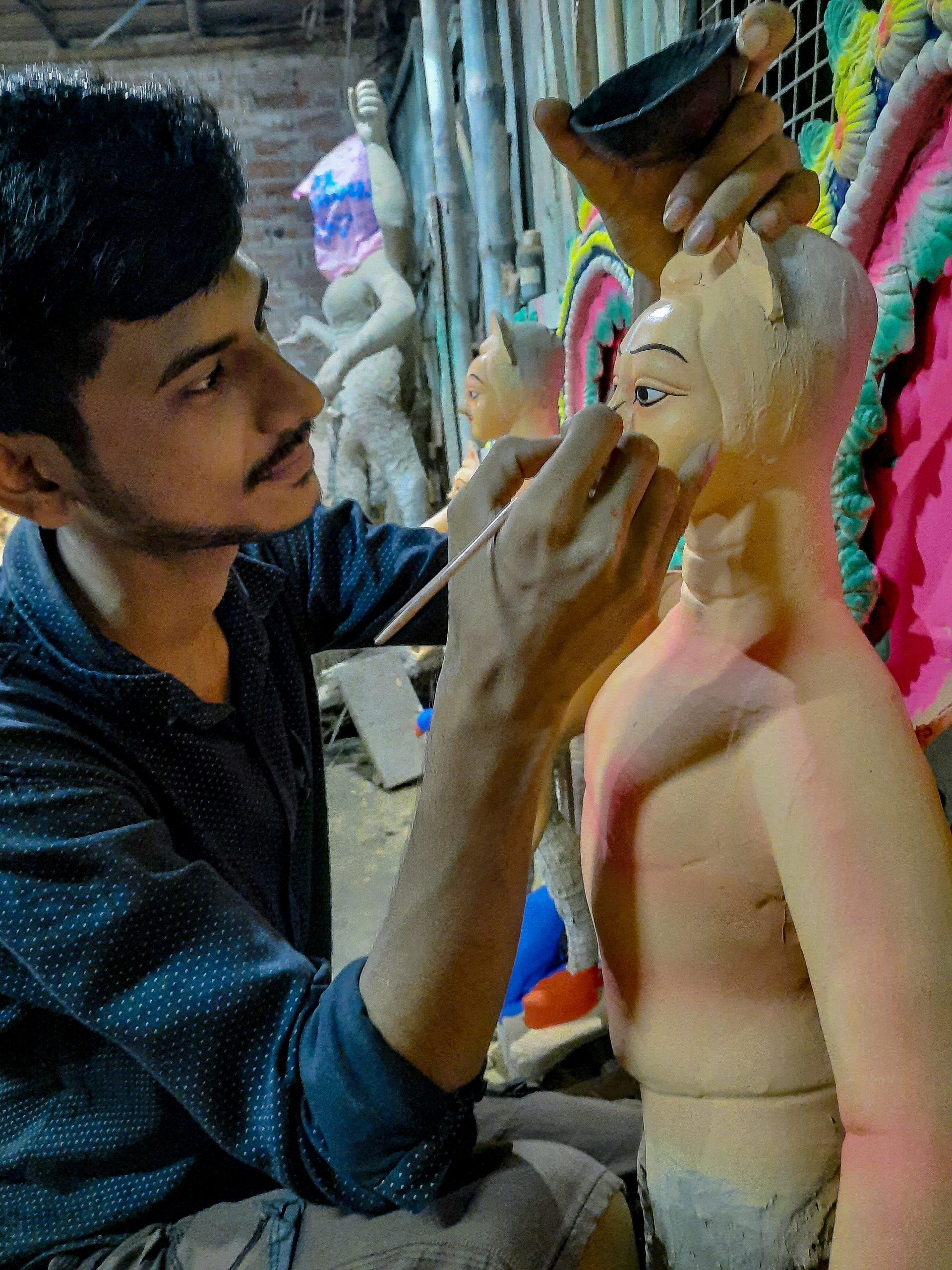 An artist painting a statue