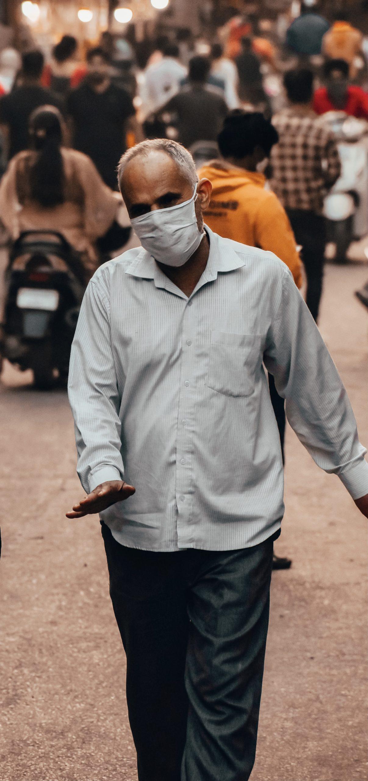 An old man walking in a street