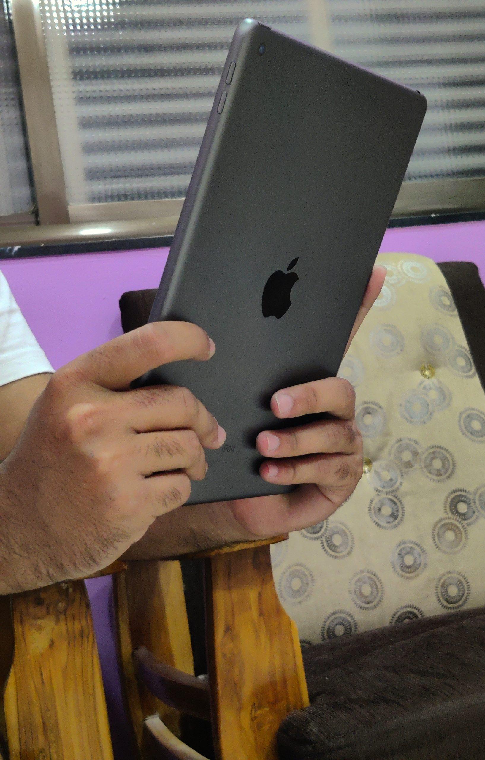 Apple iPad in hand