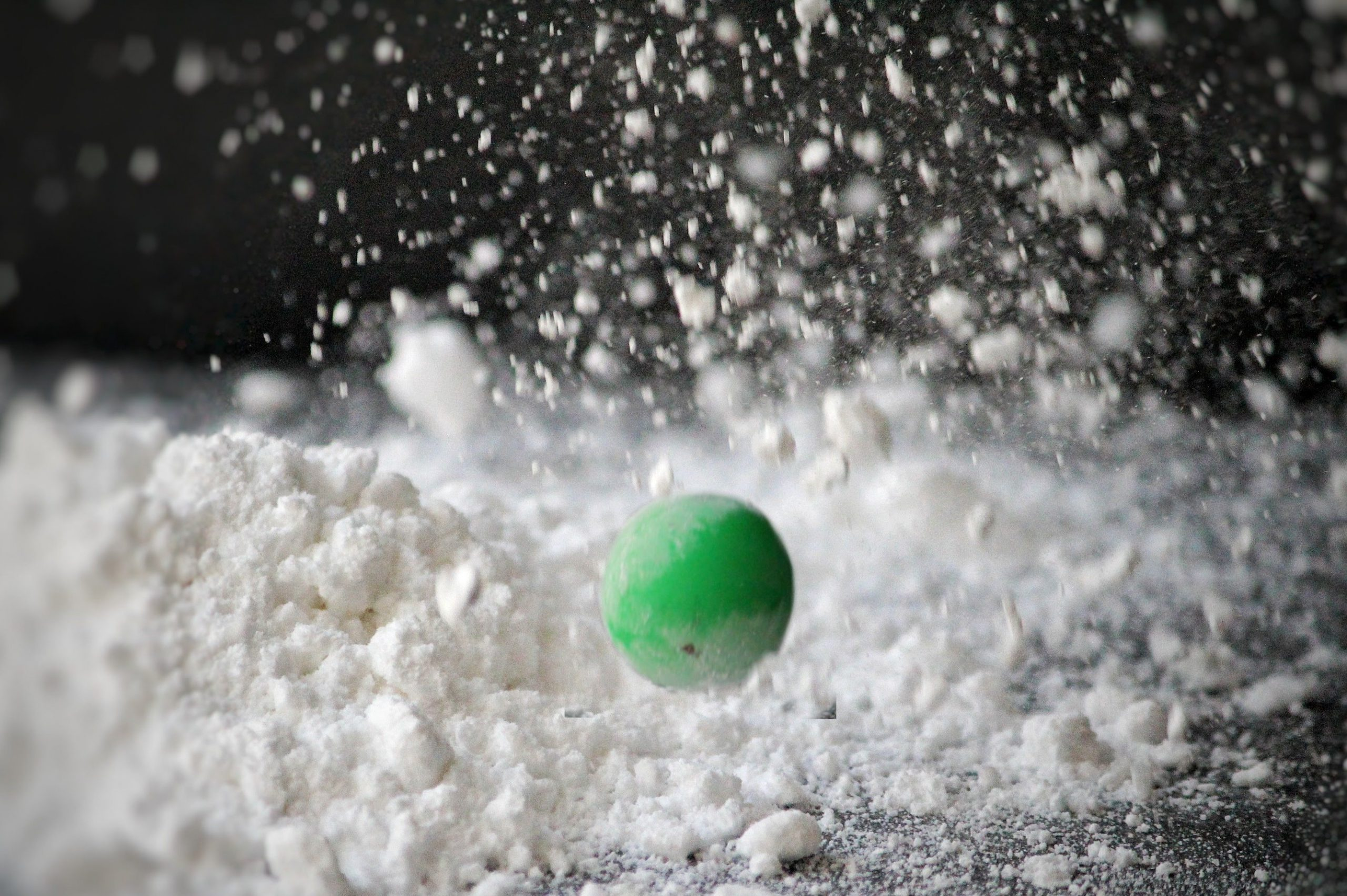 Ball bounding on powder