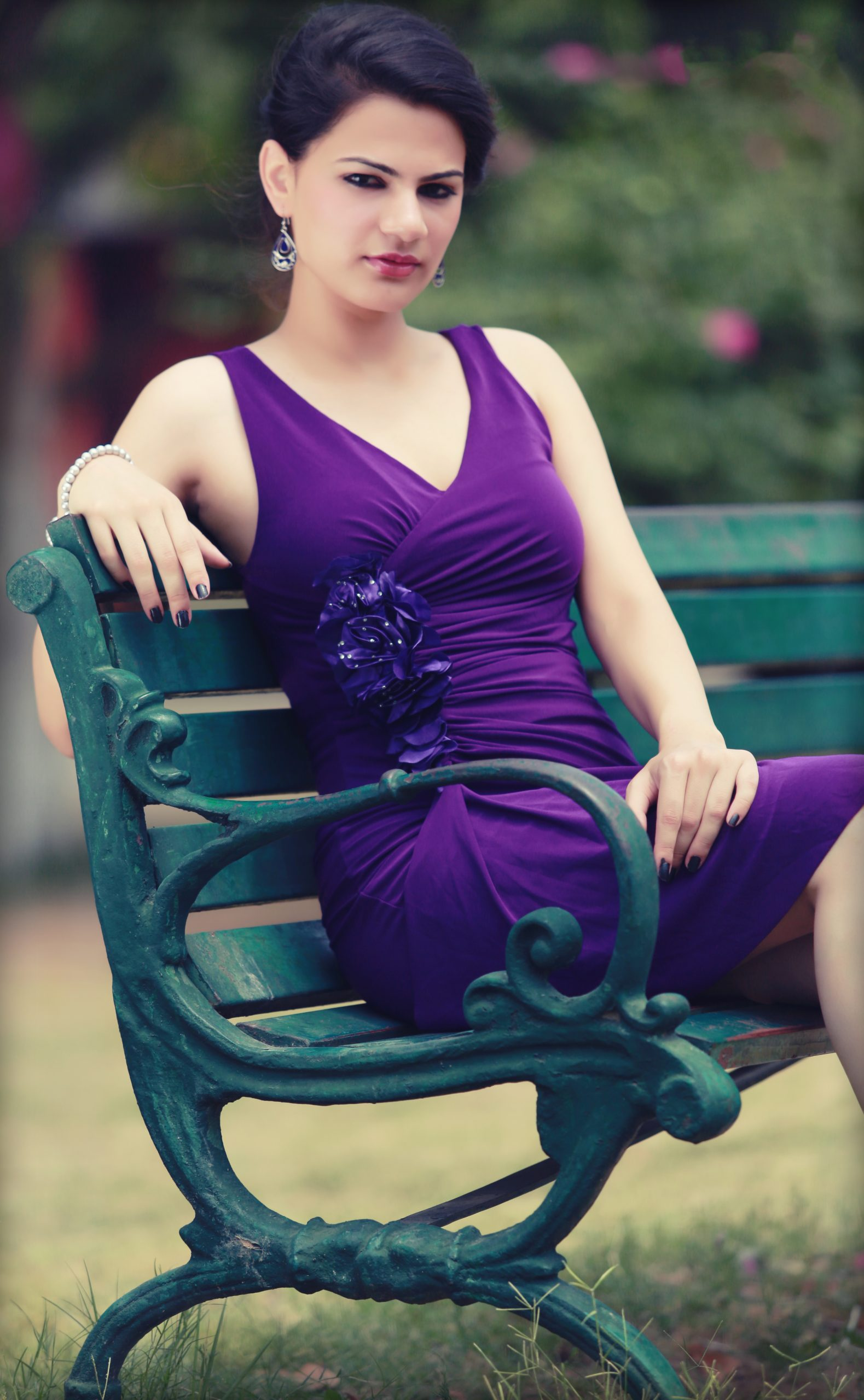 woman posing on bench