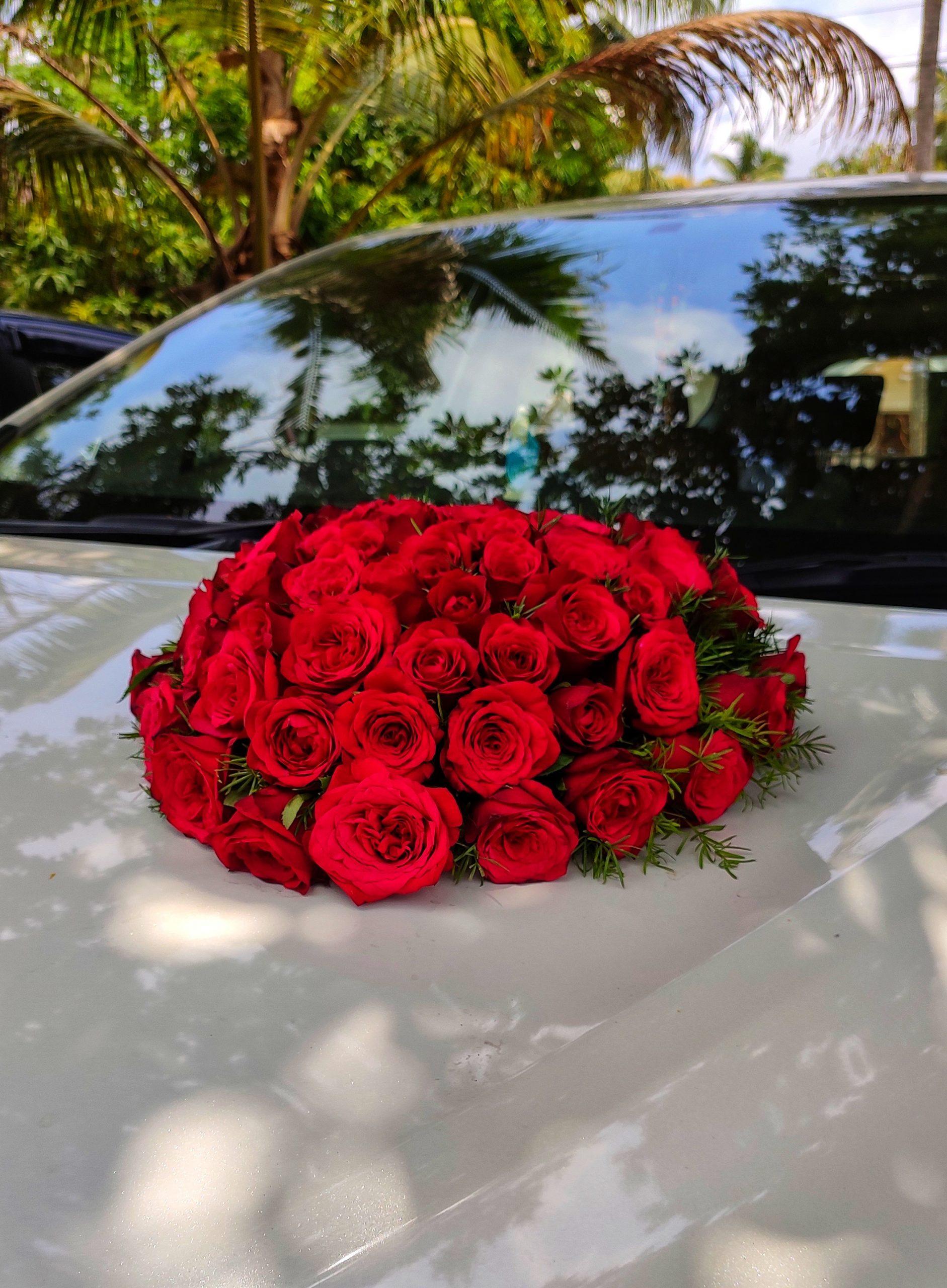 bouquet of roses on a car bonnet