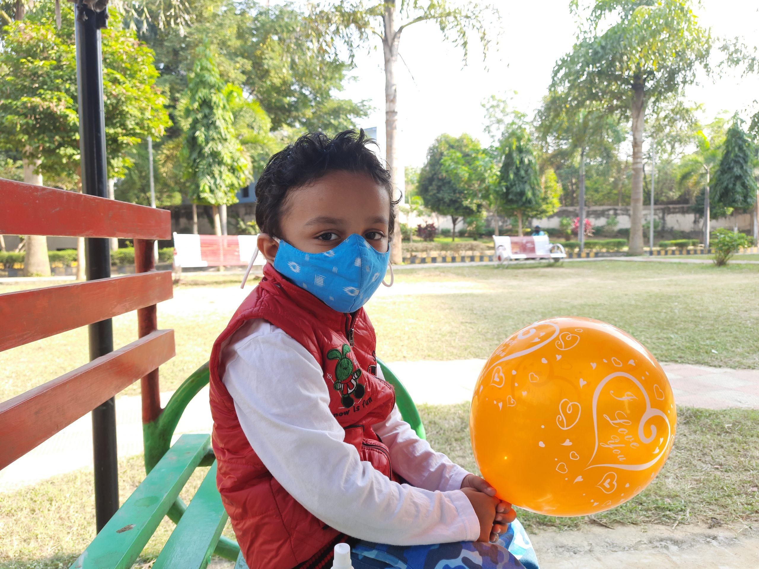 A little boy with balloon