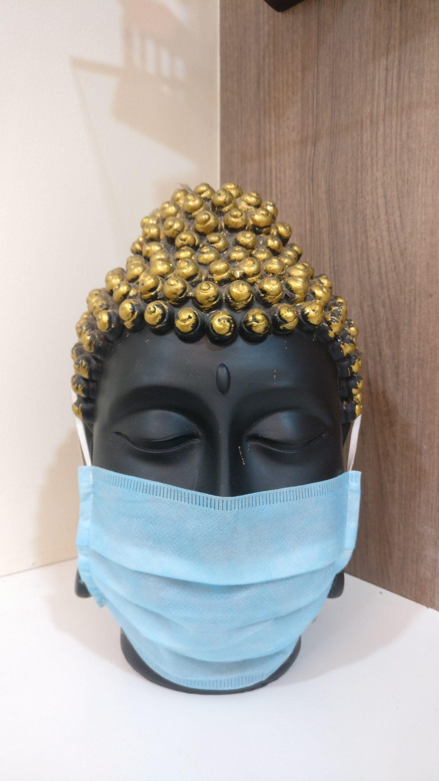 Buddha head statue with mask