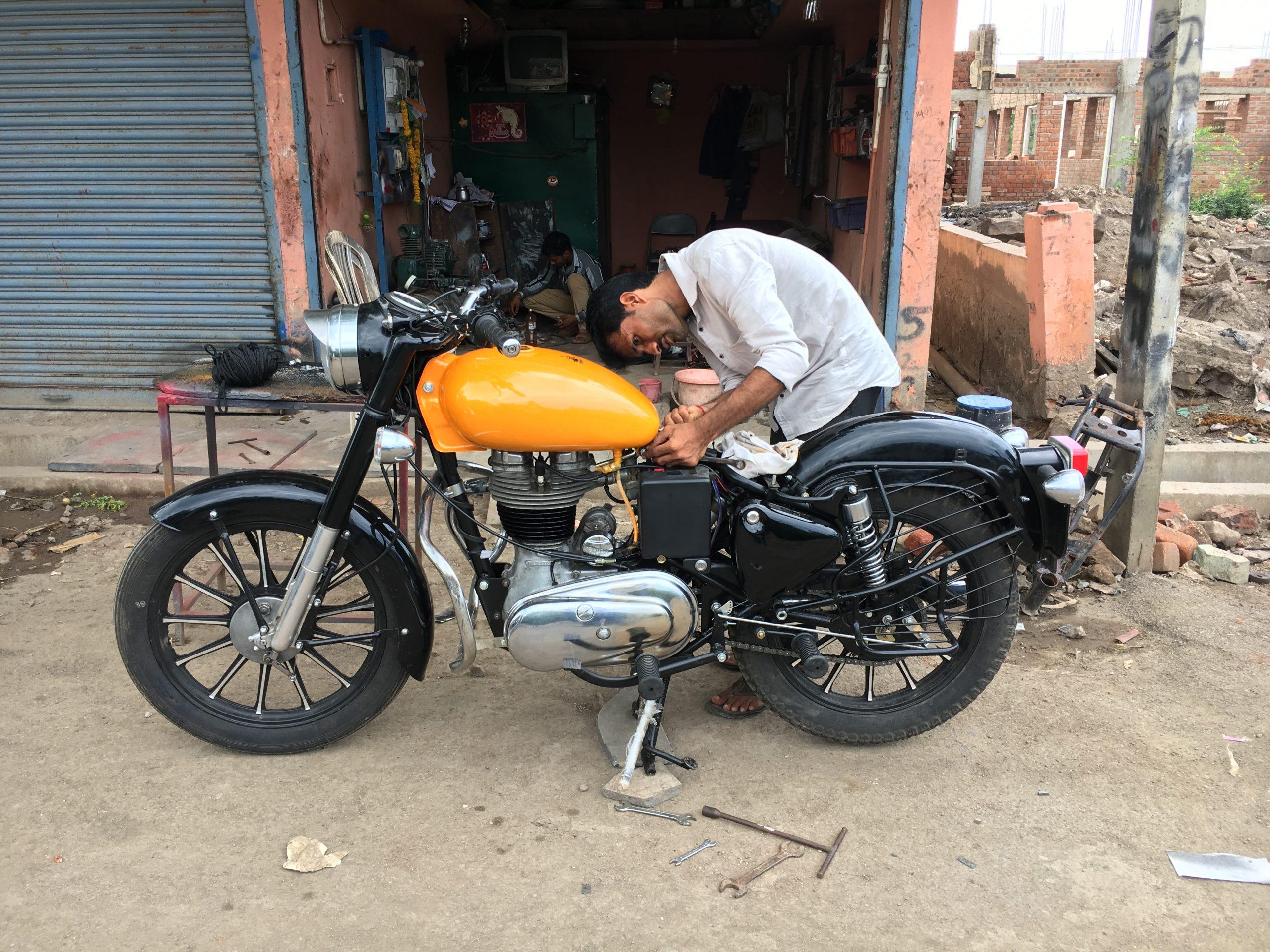 mechanic repairing bike