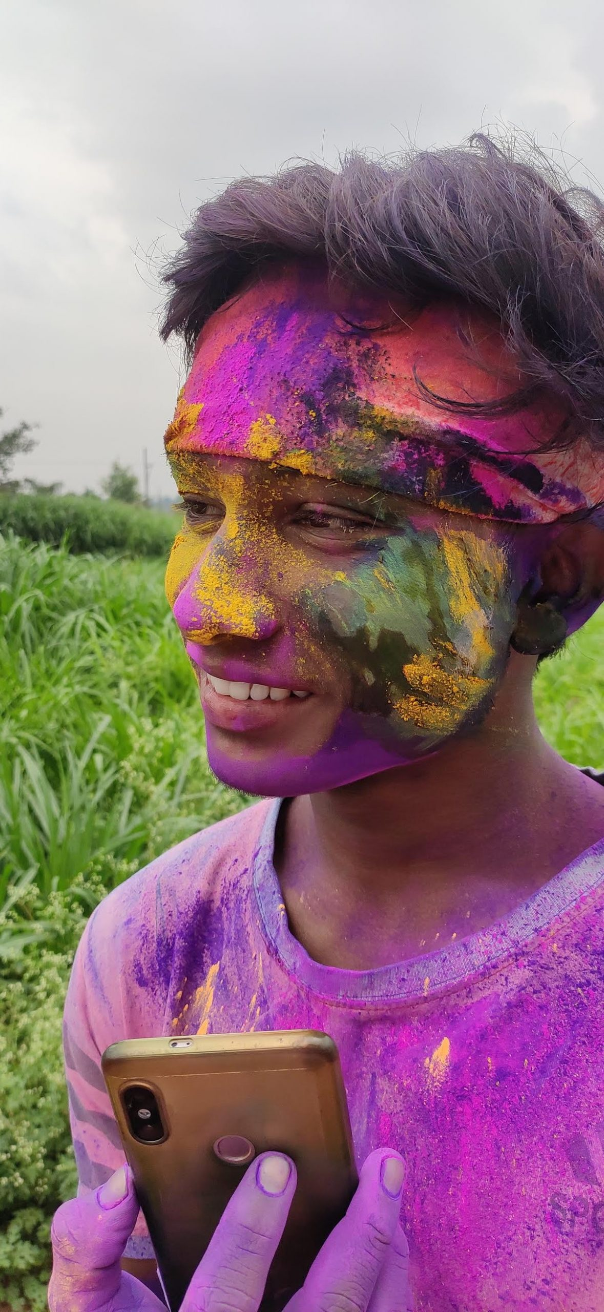 man with holi colors on face