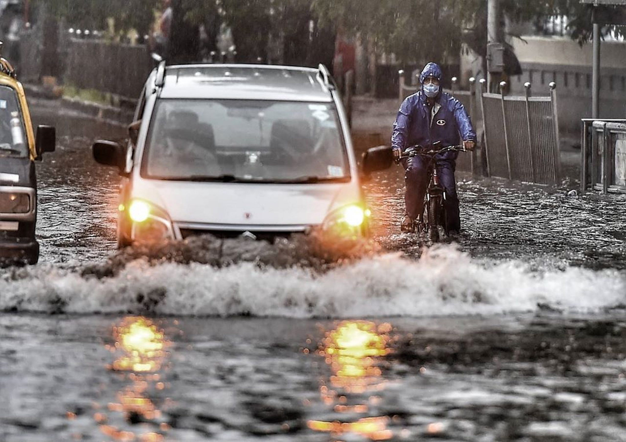vehicles in waterlogged road
