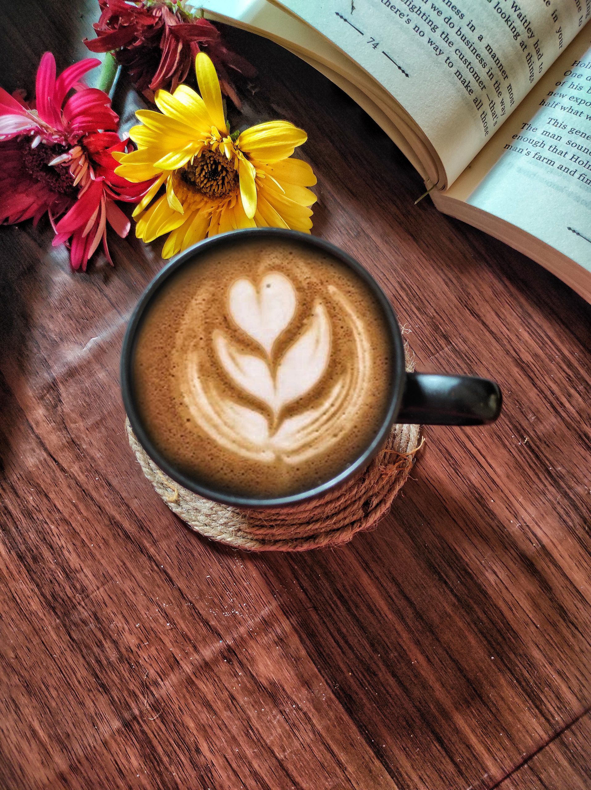 coffee, book and flowers