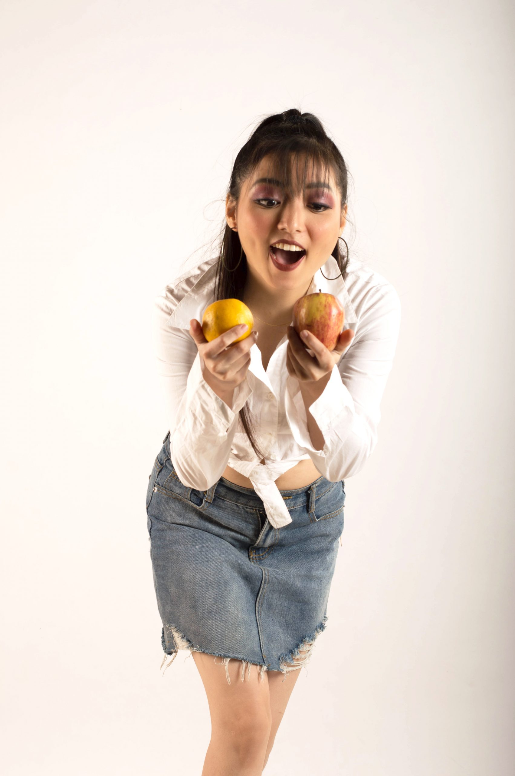 Girl having fun with fruits