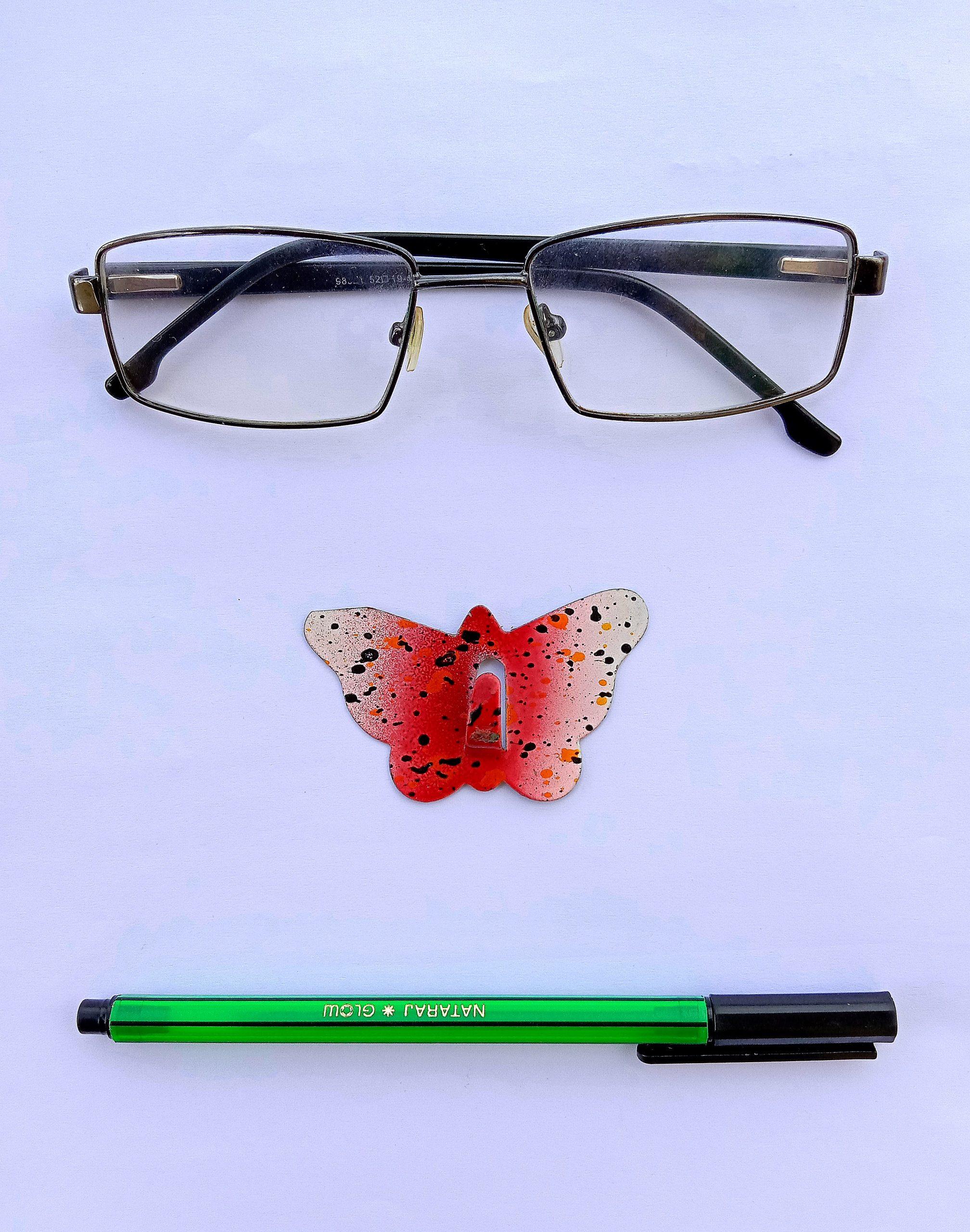 A pen and eyeglasses