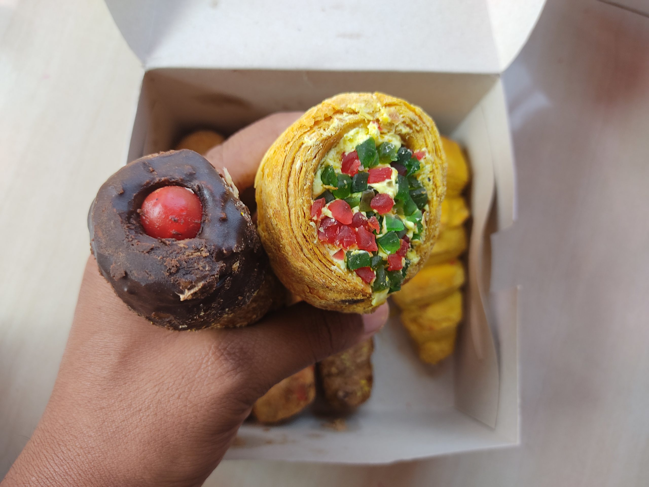 Hand holding bakery rolls