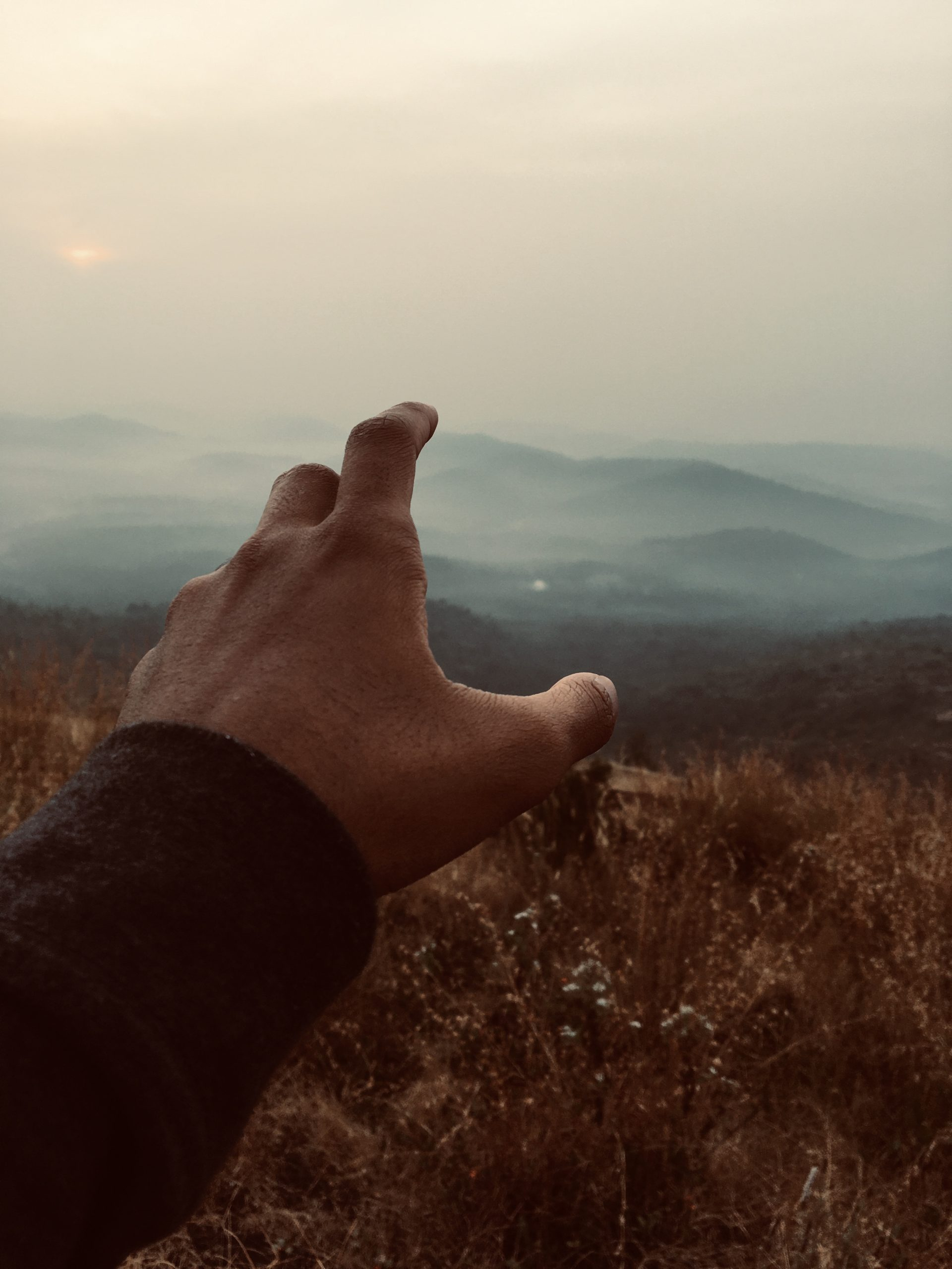 Hand towards mountains