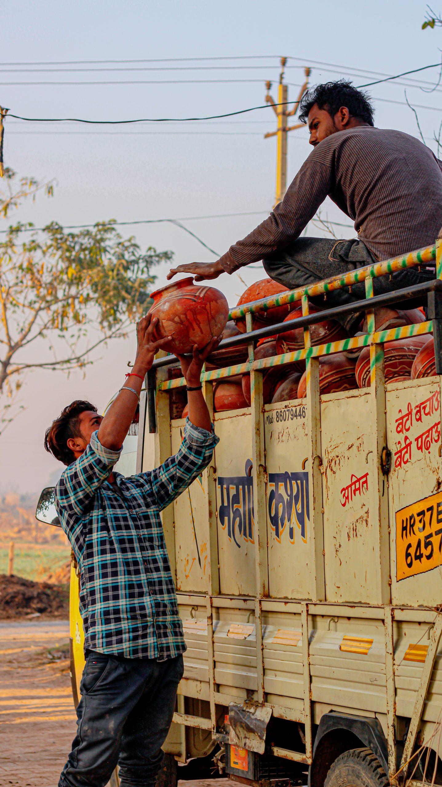 Men unloading a truck