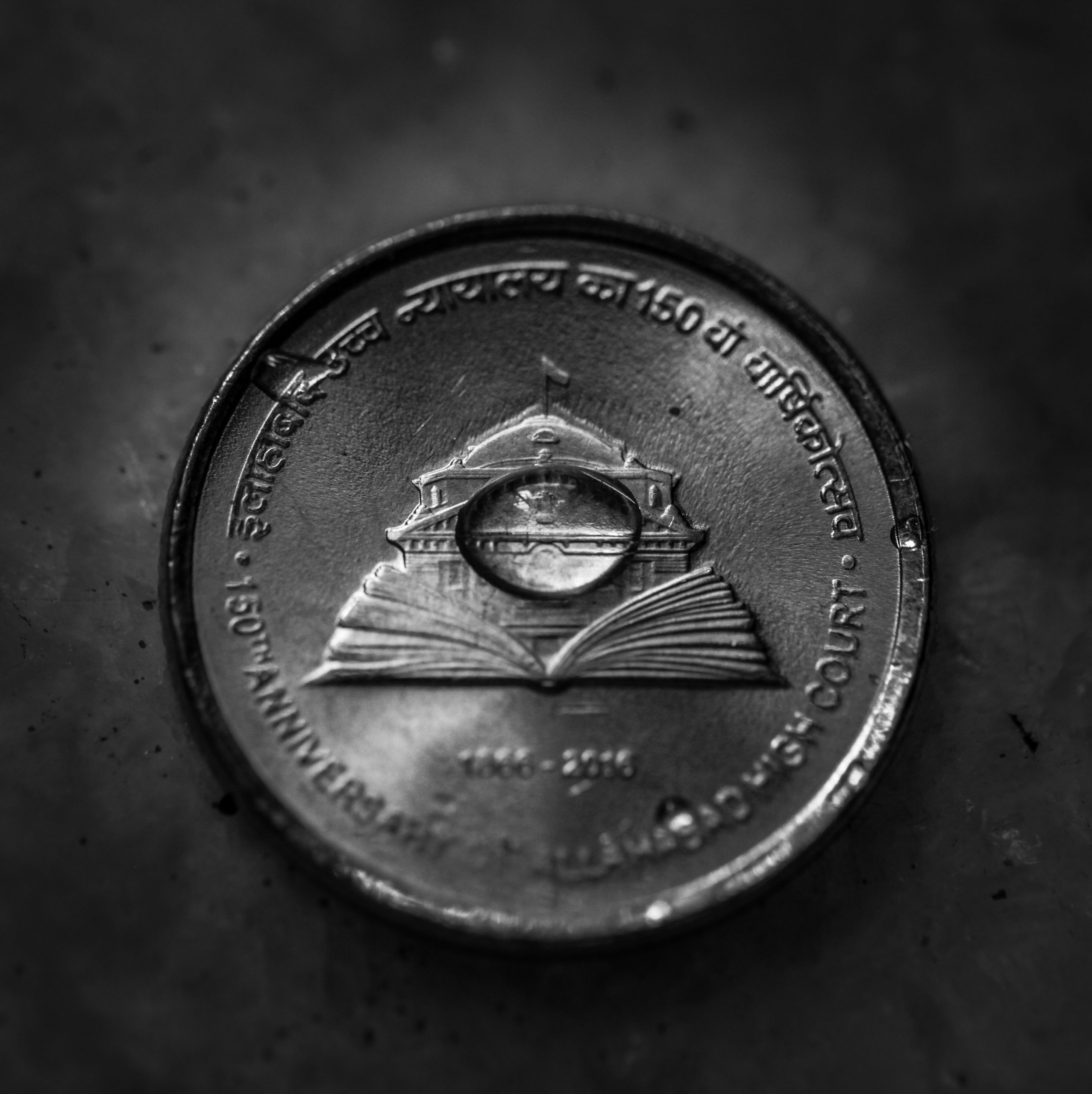 Water drop on coin