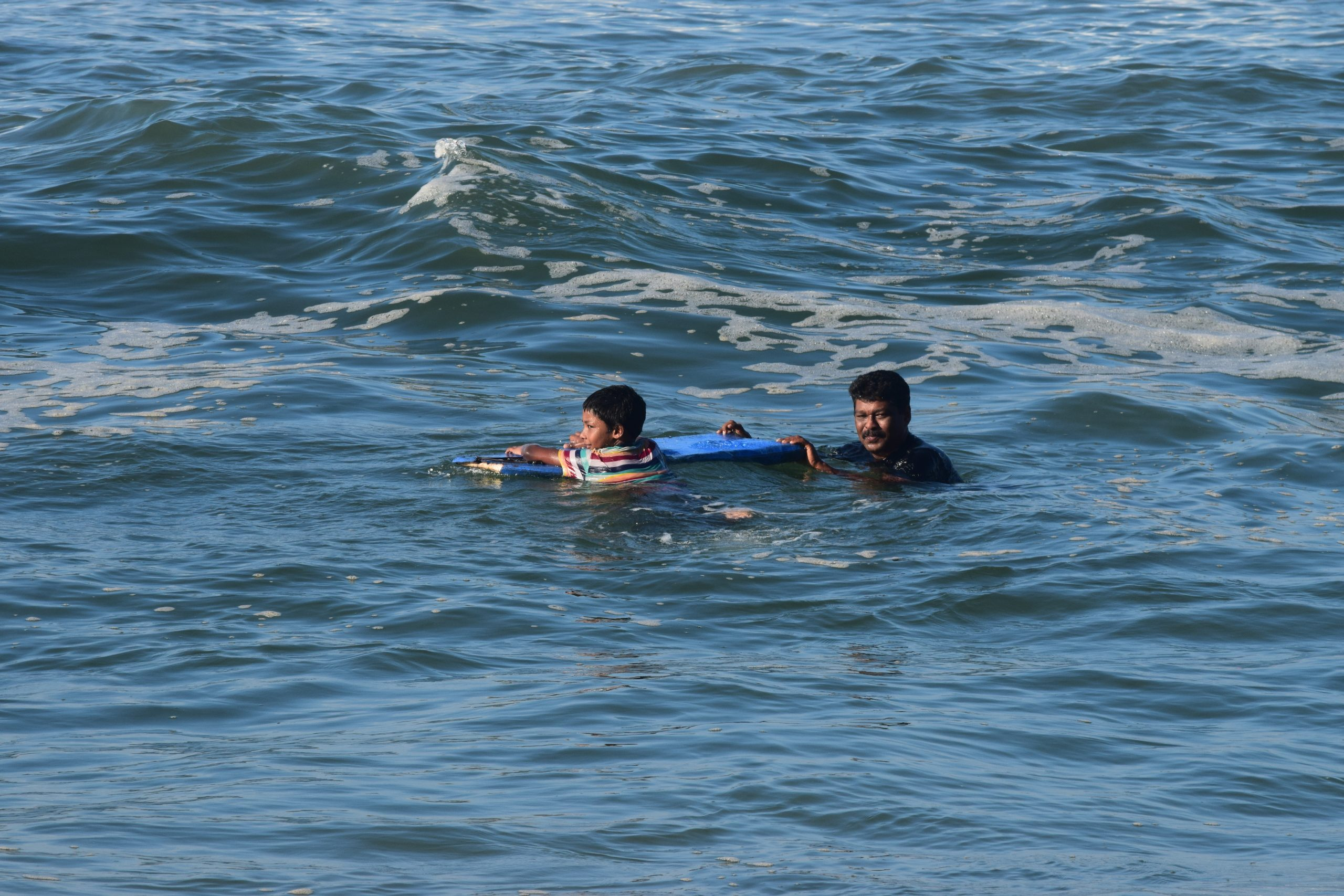 Father and son in a sea