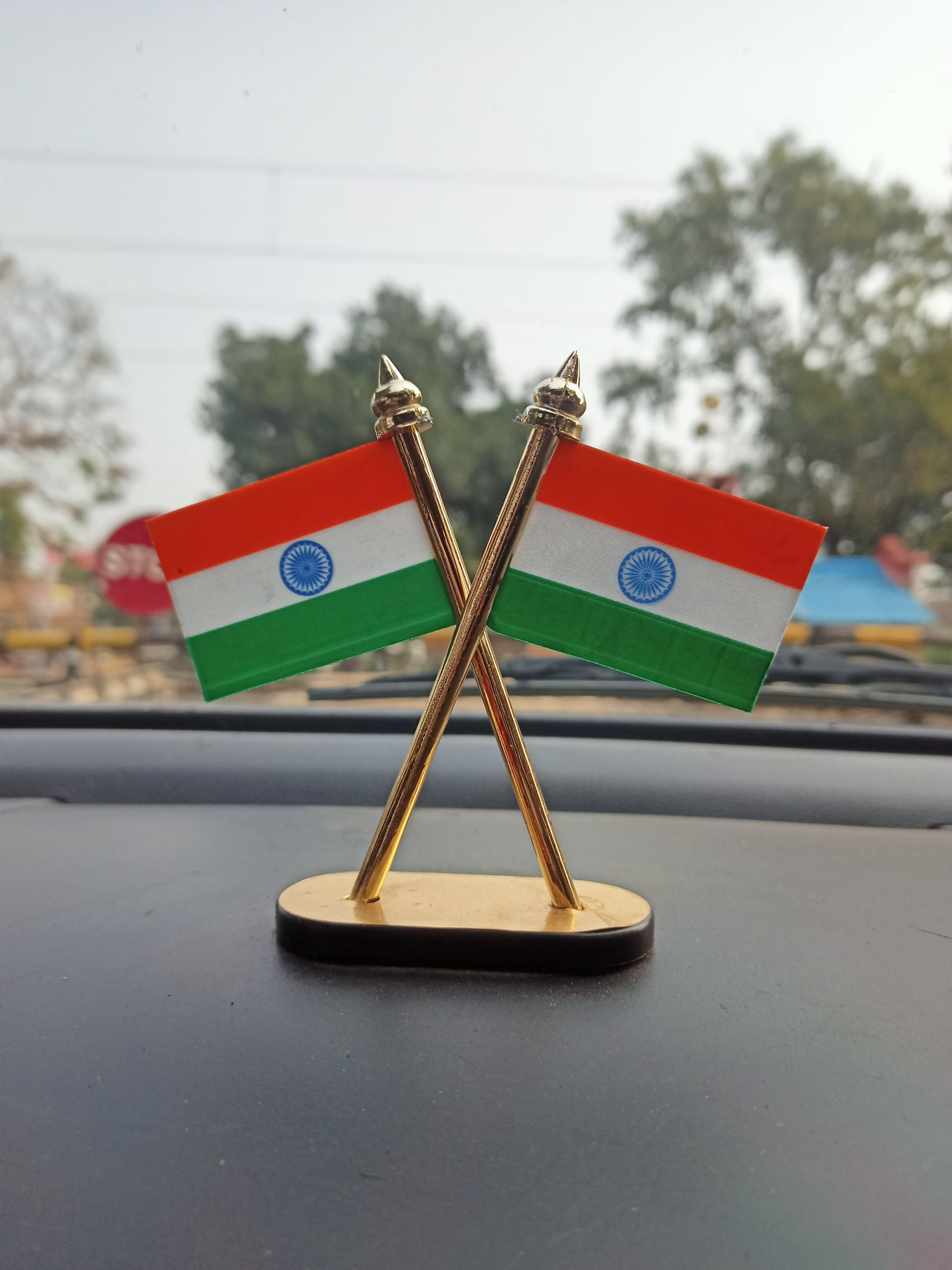 Indian flags on car dashboard