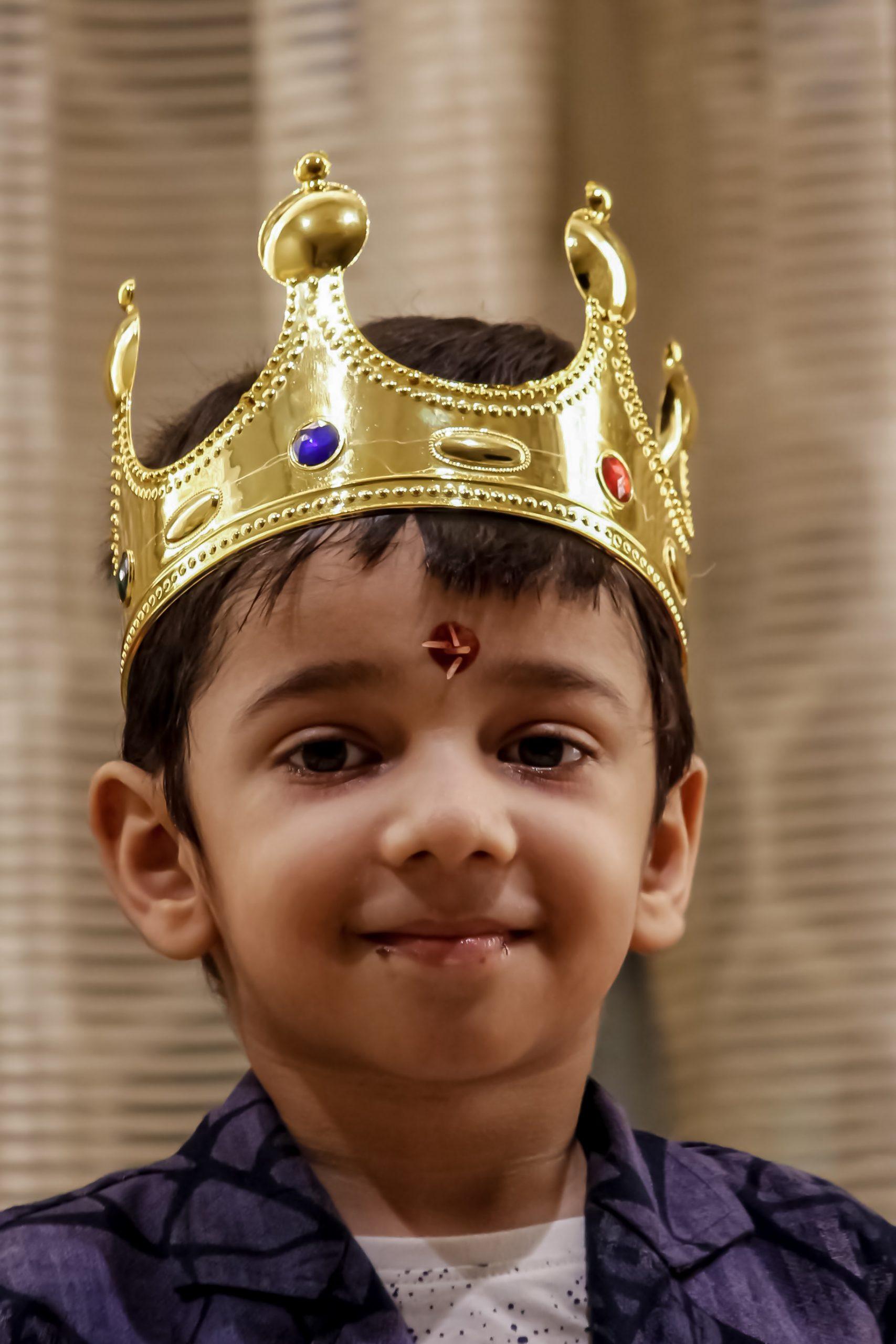 Kid wearing a crown