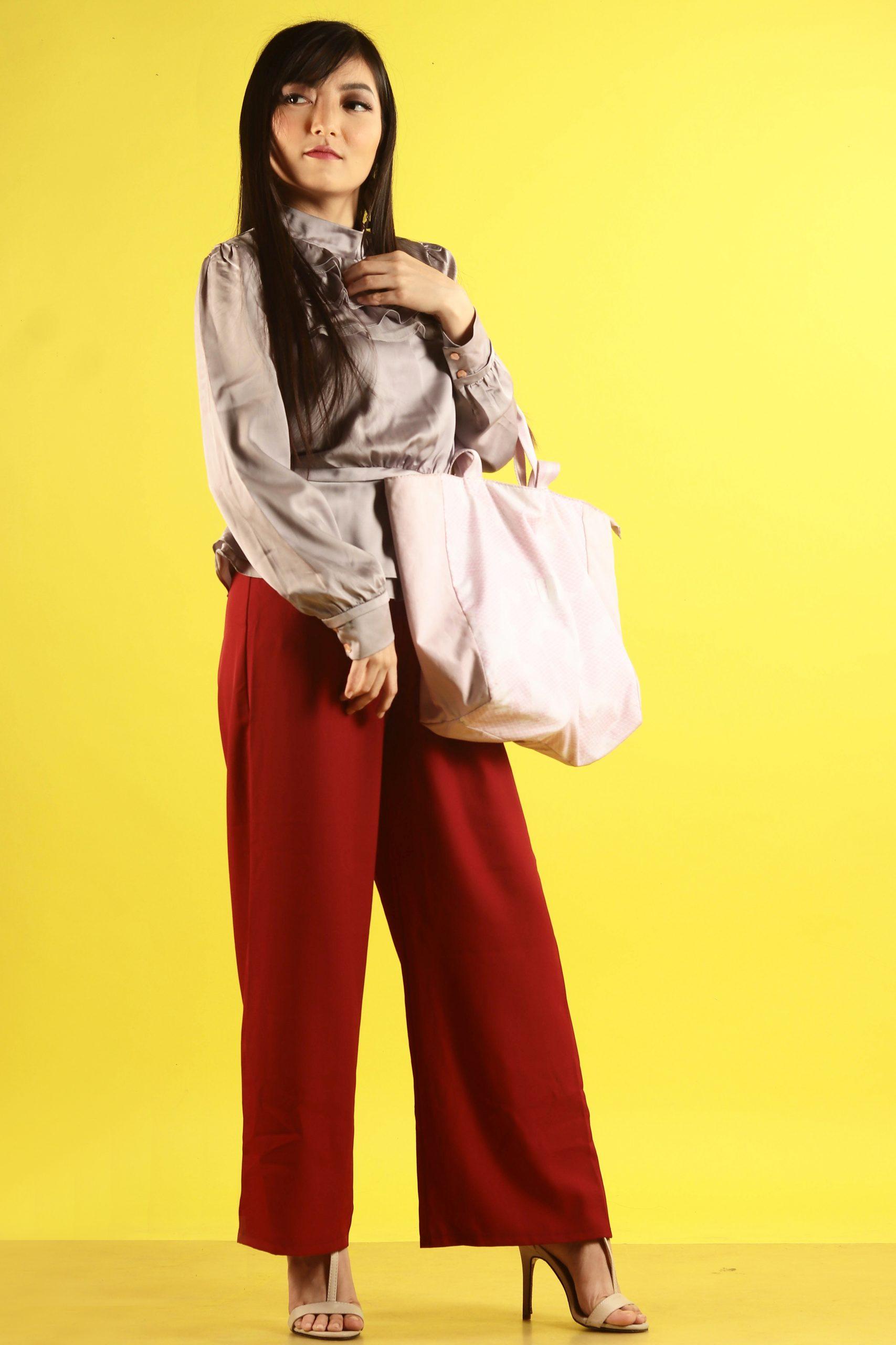 girl posing with handbag