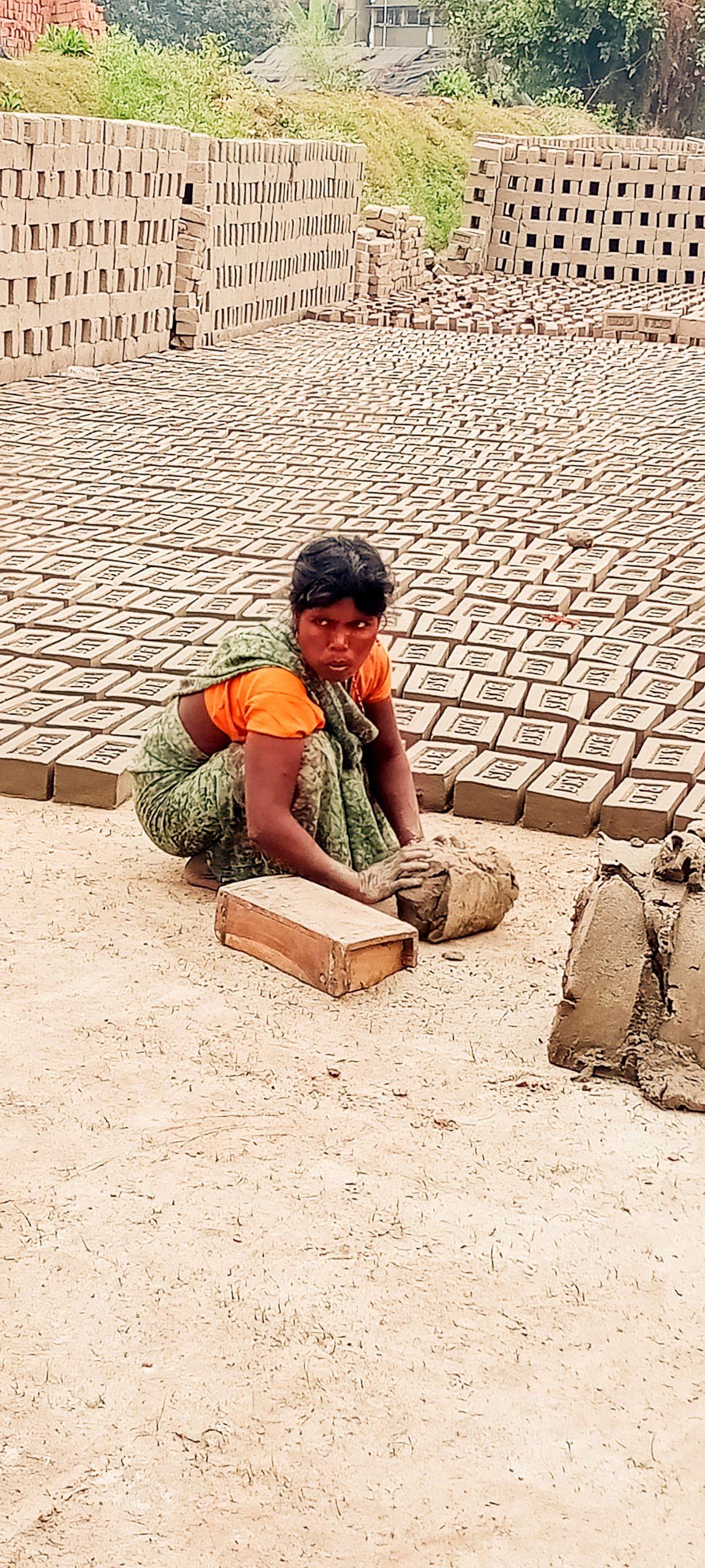 A lady making bricks